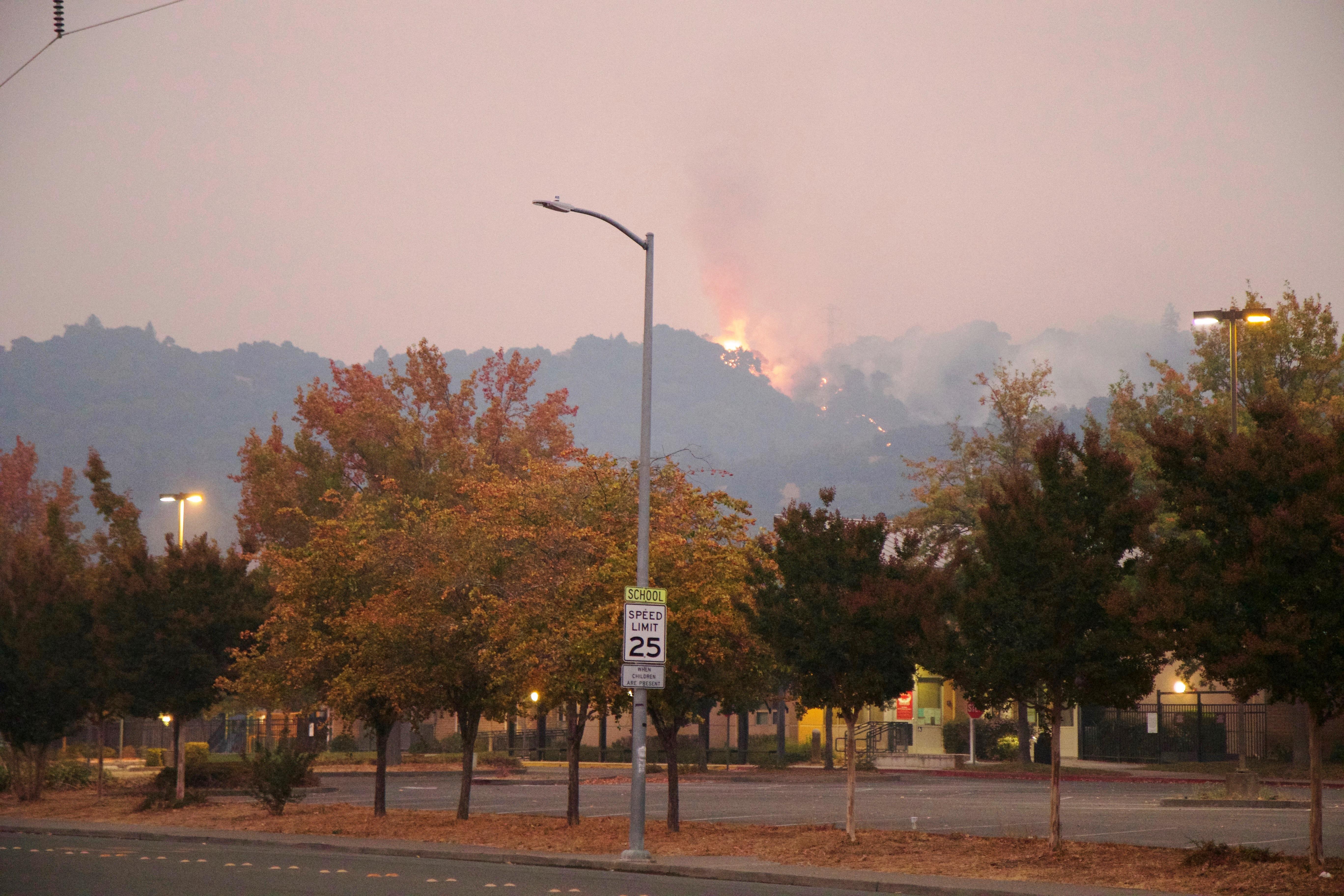 Fire on a mountain overlooking a Santa Rosa street.