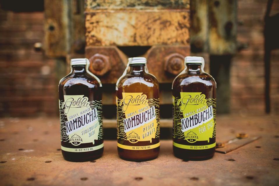 Three bottles of Golda Kombucha.