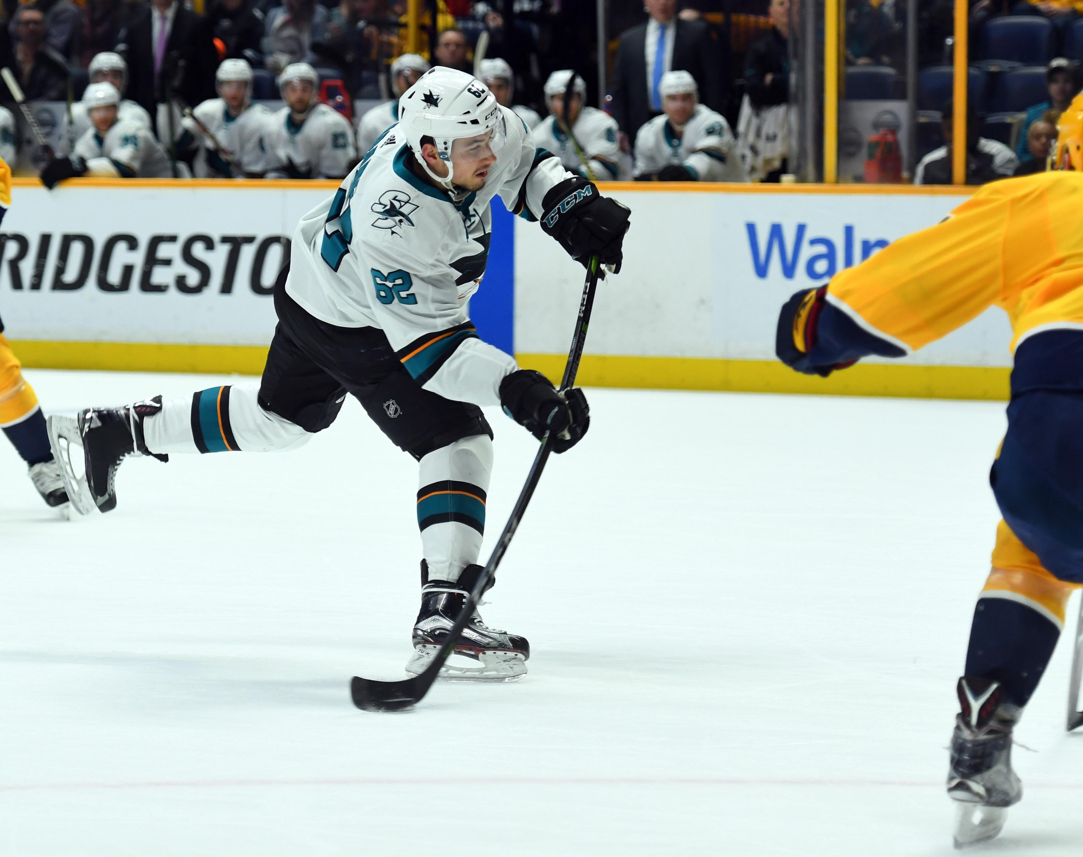 Feb 22, 2018; Nashville, TN, USA; San Jose Sharks right wing Kevin Labanc (62) shoots the puck during the second period against the Nashville Predators at Bridgestone Arena.