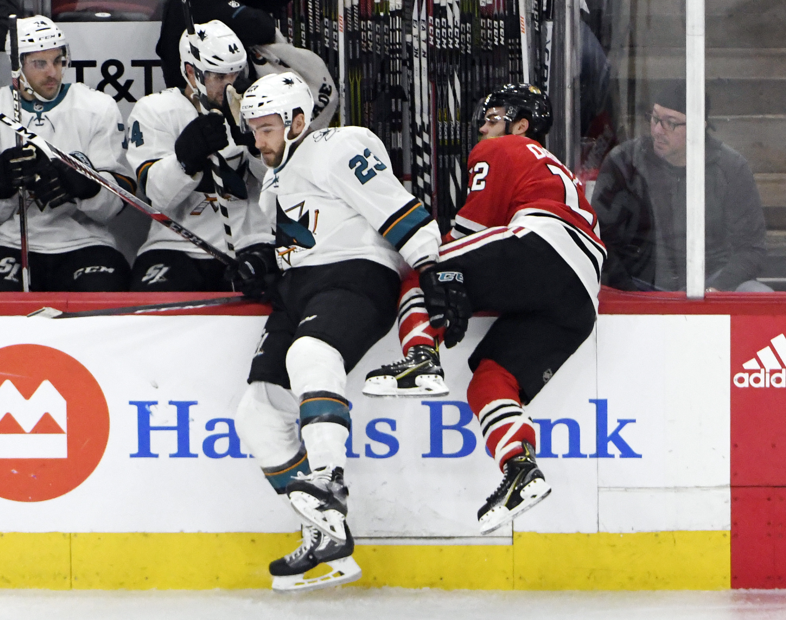 Mar 26, 2018; Chicago, IL, USA; San Jose Sharks right wing Barclay Goodrow (23) checks Chicago Blackhawks right wing Alex DeBrincat (12) during the second period at United Center.