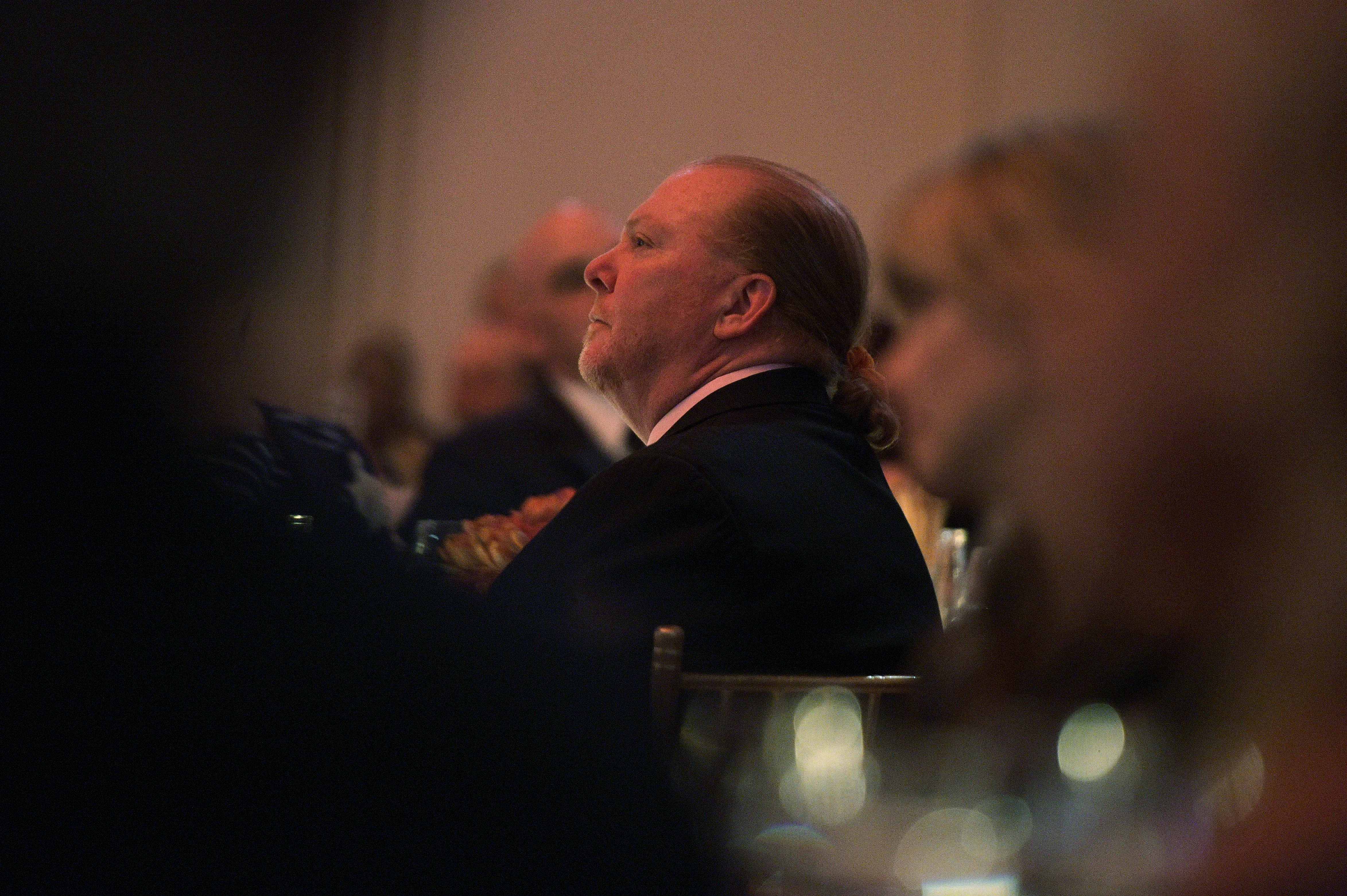 A man, Mario Batali, seated in profile