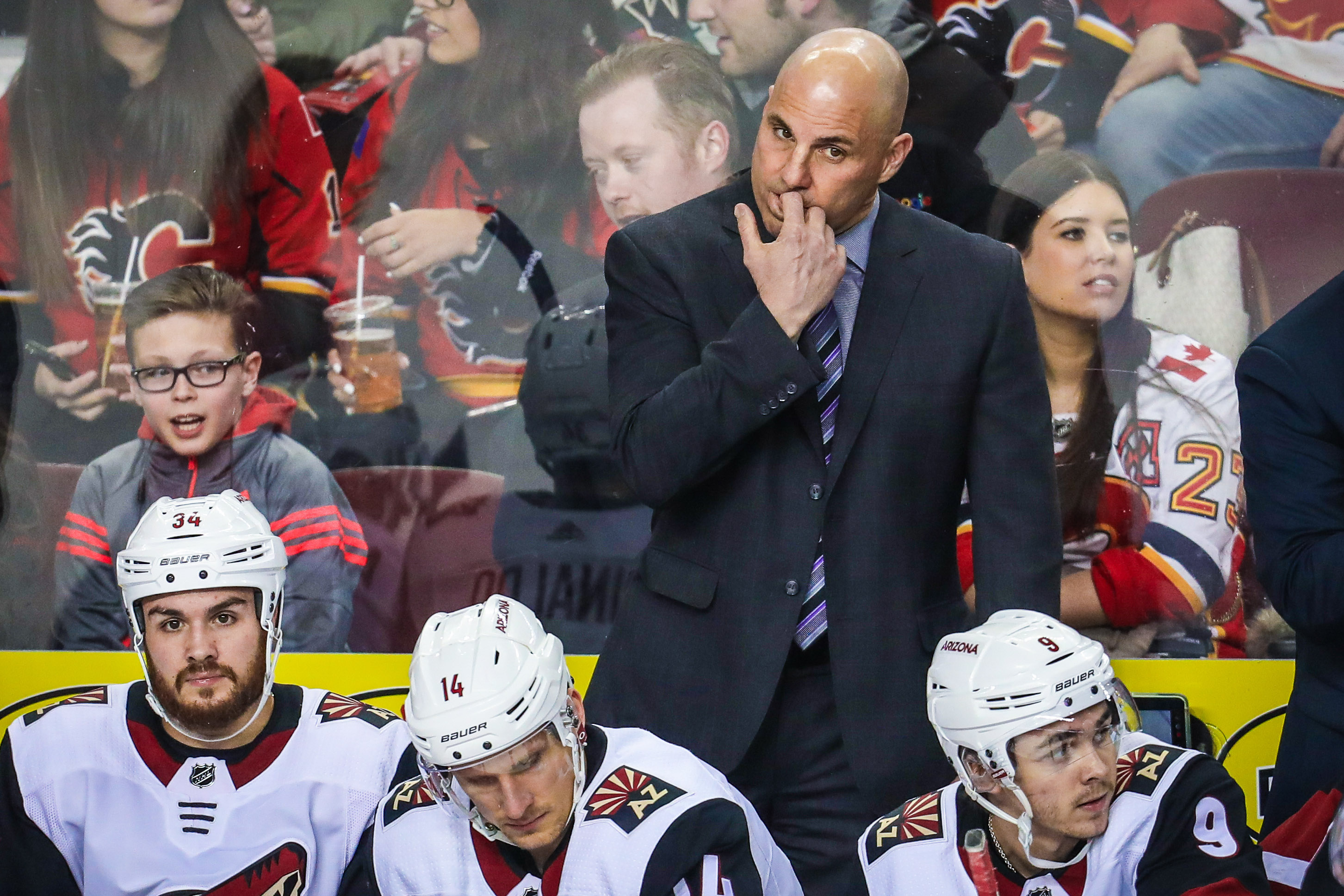 Apr 3, 2018; Calgary, Alberta, CAN; Arizona Coyotes head coach Rick Tocchet on his bench during the first period against the Calgary Flames at Scotiabank Saddledome