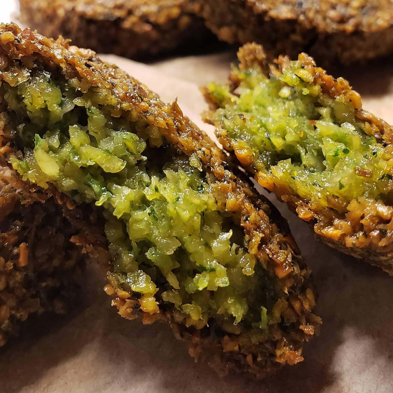 A closeup of falafel, revealing a rich green interior