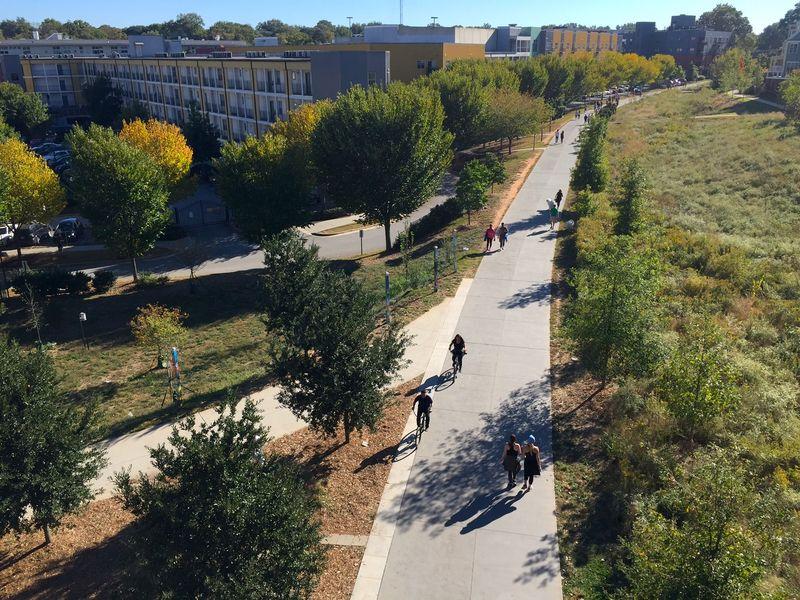People walk and bike on the Atlanta Beltline's Eastside Trail.