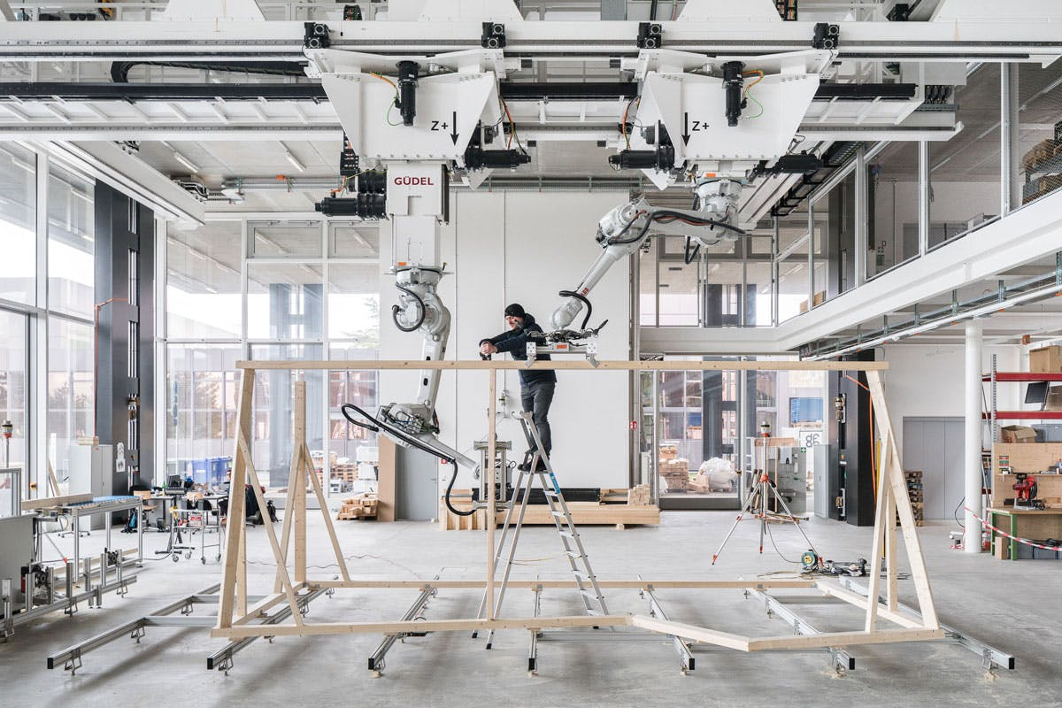 Watch robots build a timber frame in no time