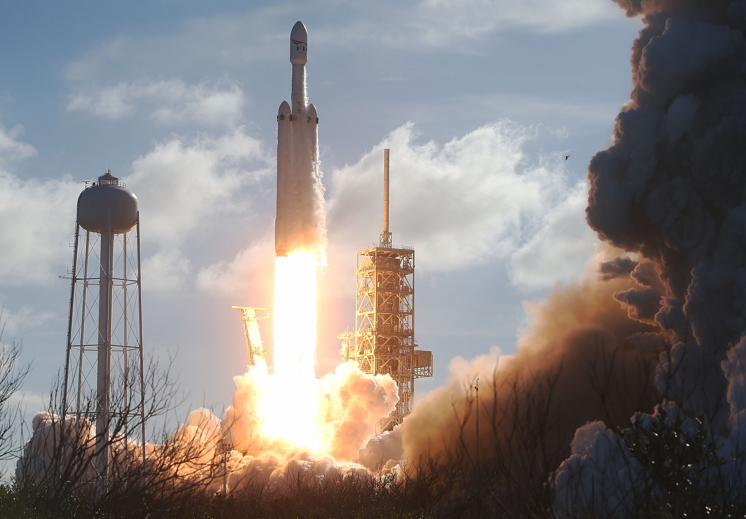 The SpaceX Falcon Heavy rocket lifts off its launch pad