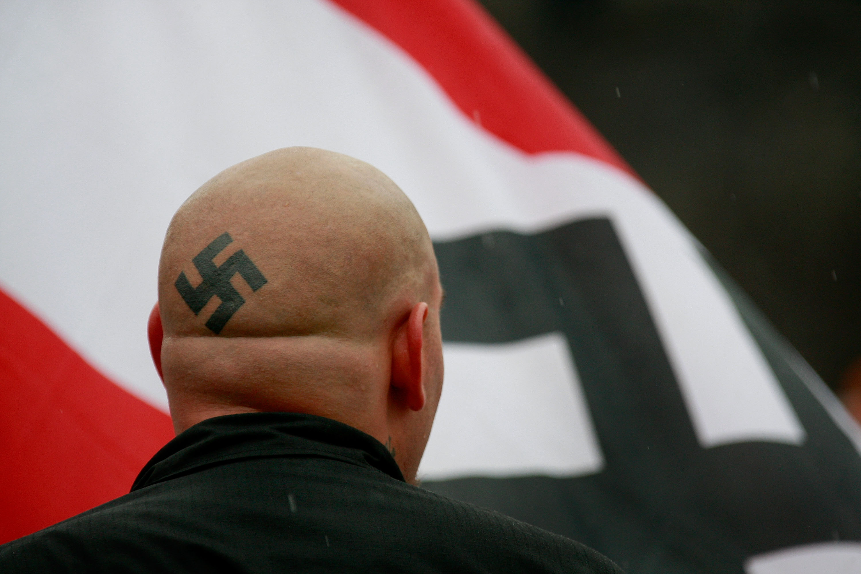 Neo-Nazi protestors organized by the National Socialist Movement demonstrate near where the grand opening ceremonies were held for the Illinois Holocaust Museum & Education Center April 19, 2009 in Skokie, Illinois.