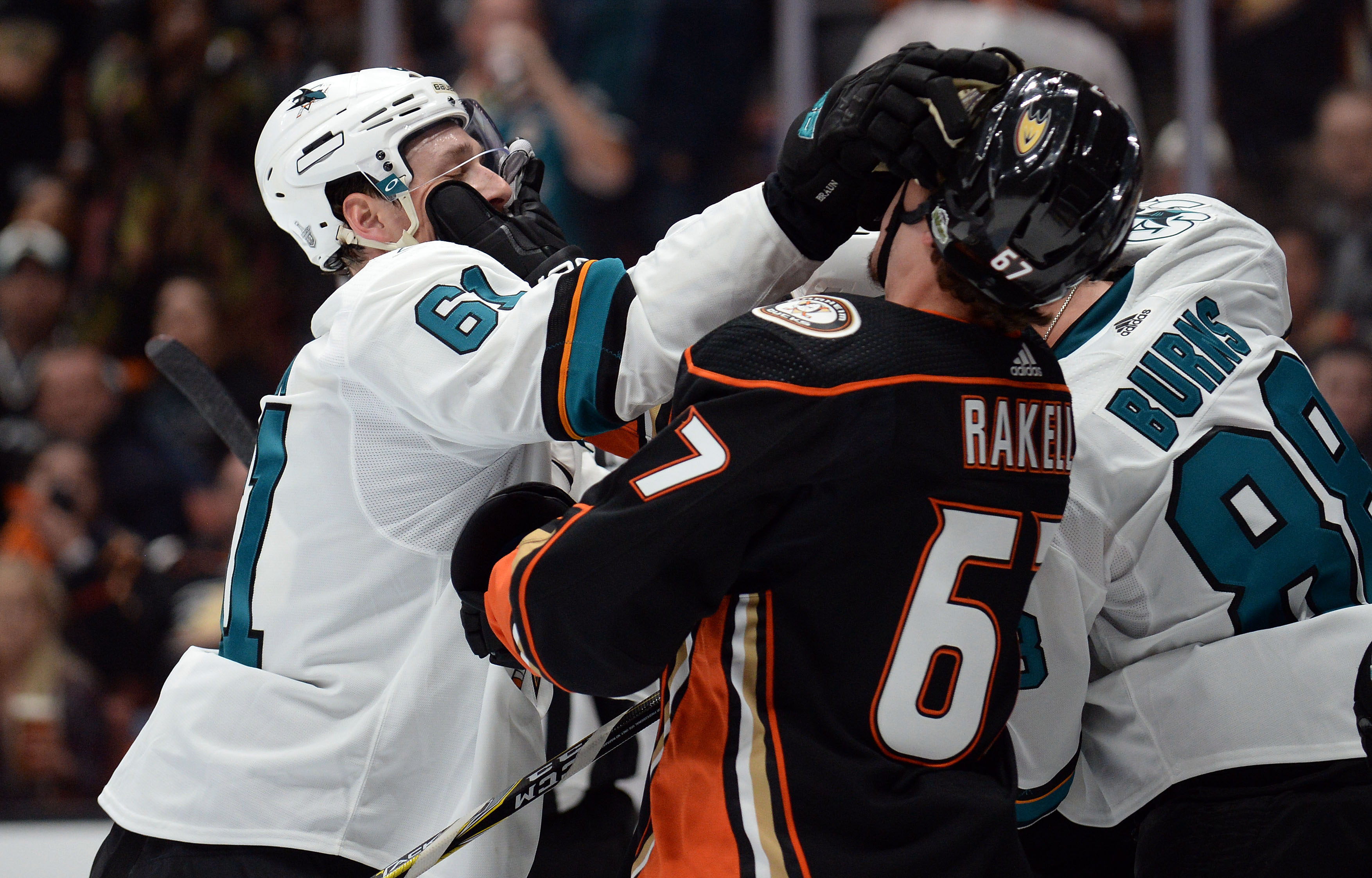 Apr 12, 2018; Anaheim, CA, USA; San Jose Sharks defenseman Justin Braun  (61) hits Anaheim Ducks center Rickard Rakell (67) during the second  period in game one of the first round of the 2018 Stanley Cup Playoffs  at Honda Center.