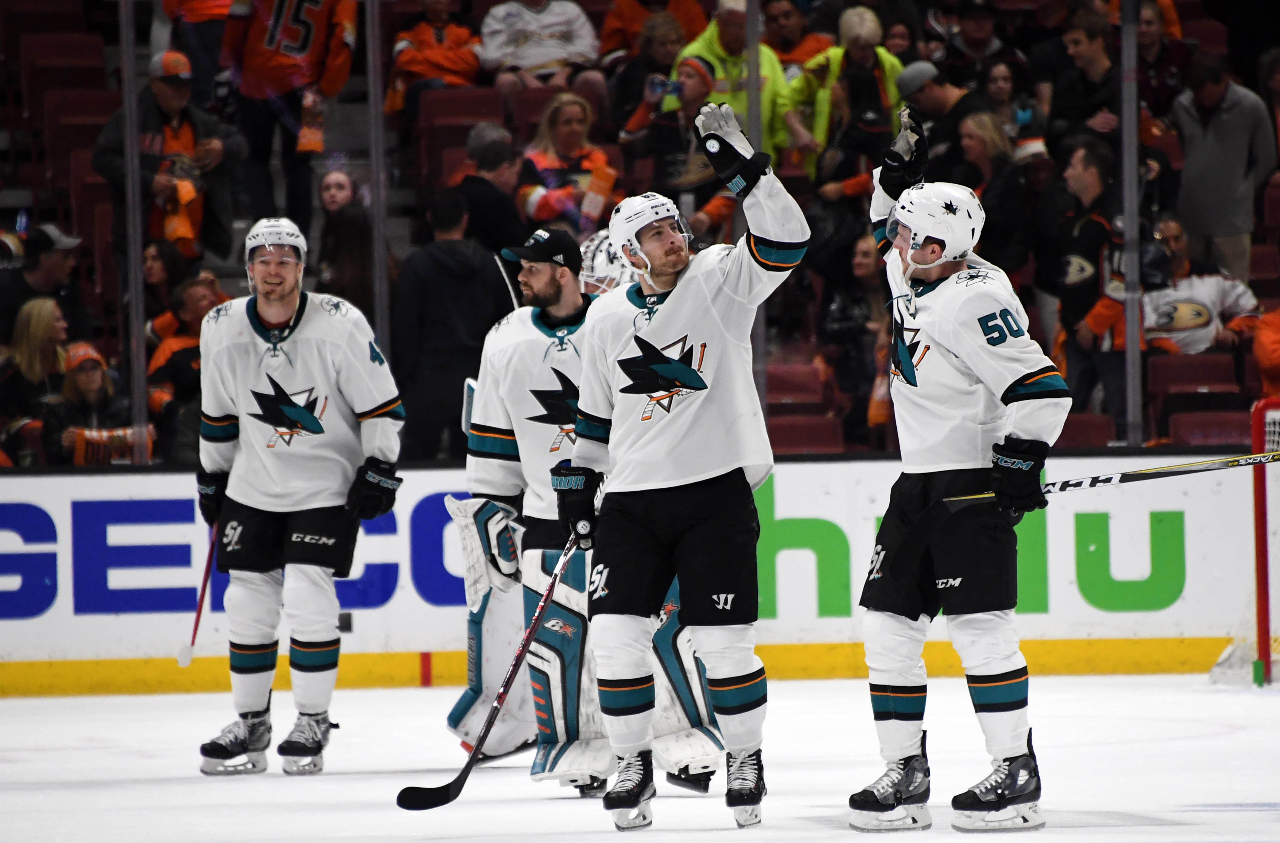 Apr 14, 2018; Anaheim, CA, USA; San Jose Sharks center Melker Karlsson  (68) and center Chris Tierney (50) celebrate after game two of the first  round of the 2018 Stanley Cup Playoffs against the Anaheim Ducks at  Honda Center. The Sharks defeated the Du
