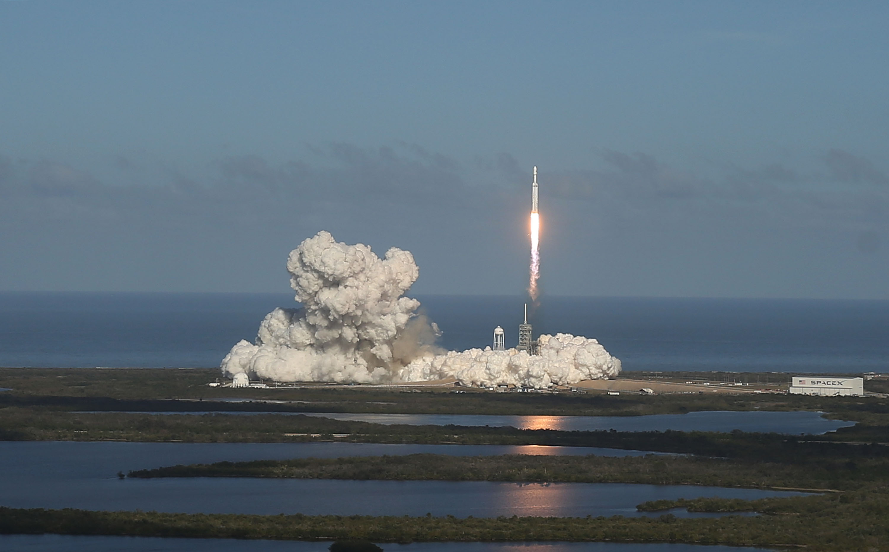 The SpaceX Falcon Heavy rocket lifts off from launch pad 39A at Kennedy Space Center