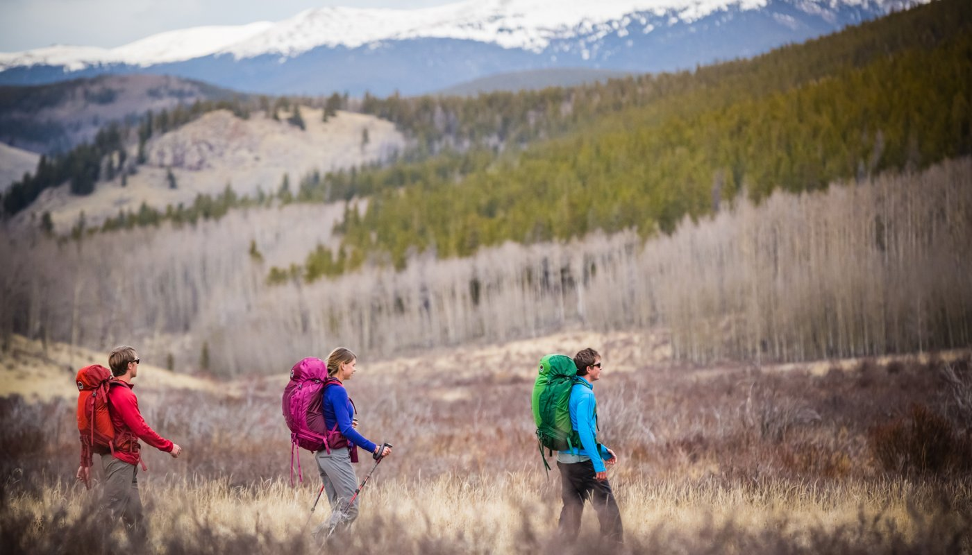 Three people hiking with backpacks