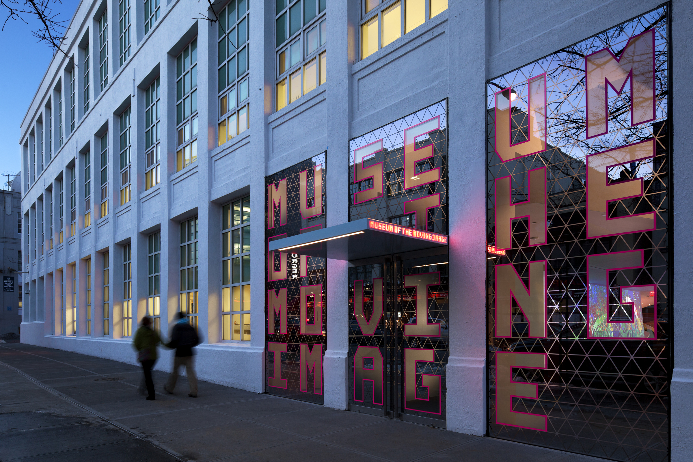two people walk past Museum of the Moving Image front entrance
