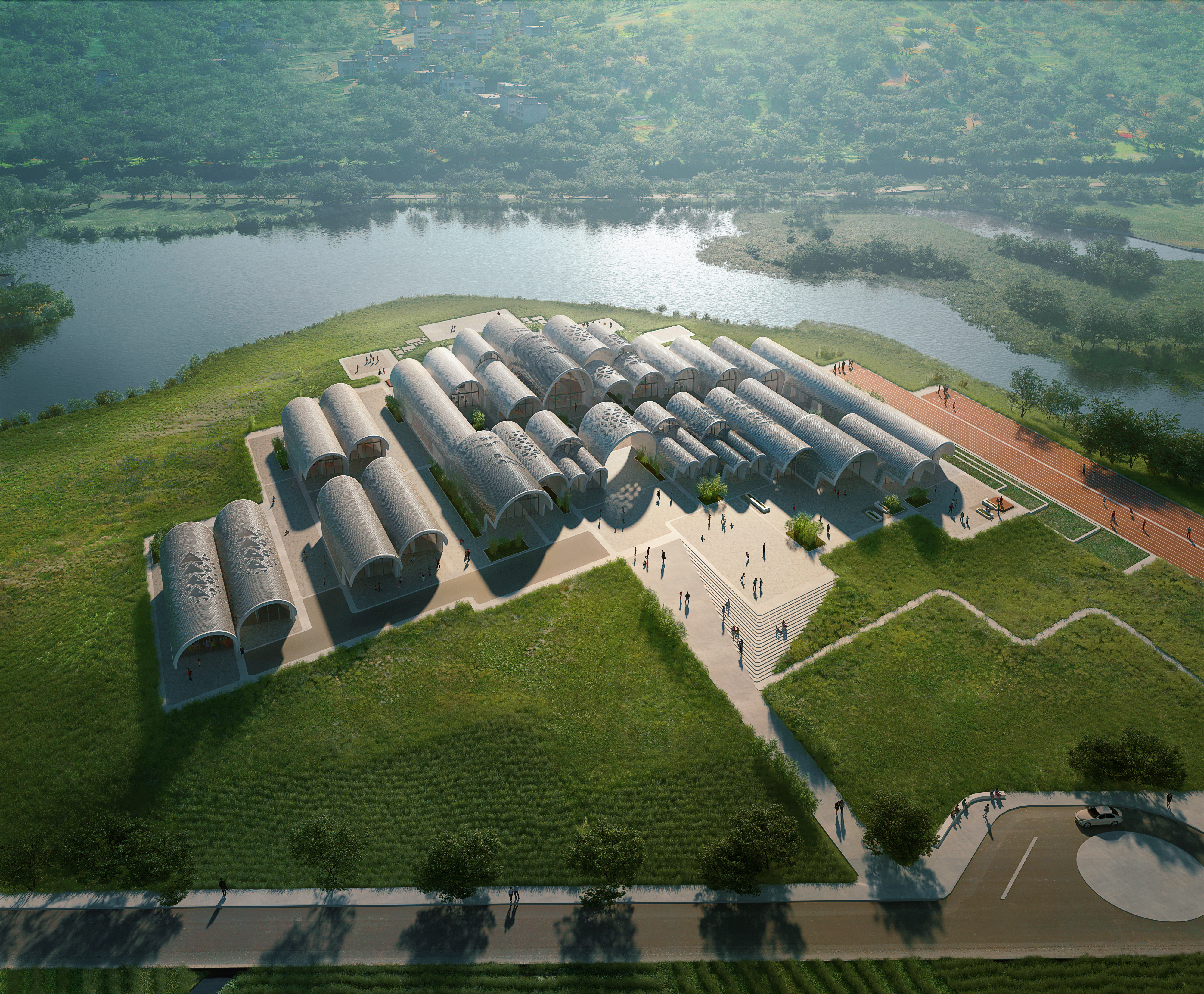 Aerial rendering of school comprising a series of long, vaulted buildings set on a grassy site by a river.