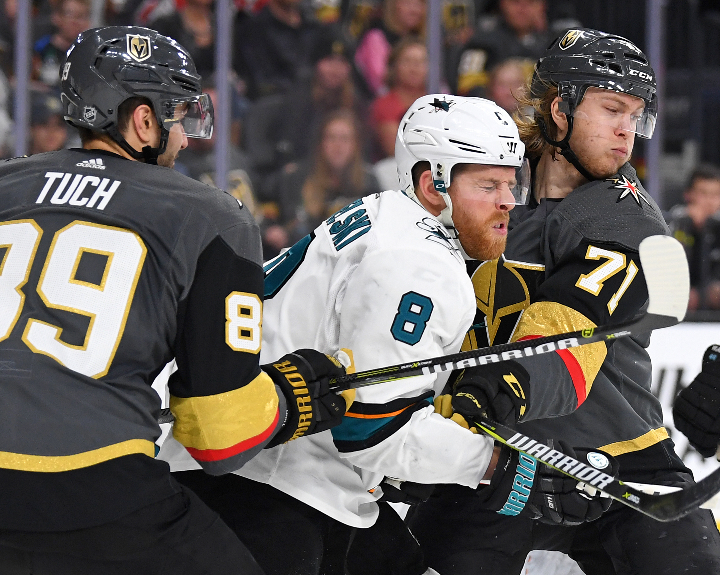 Mar 31, 2018; Las Vegas, NV, USA; San Jose Sharks center Joe Pavelski (8) is checked by Vegas Golden Knights center William Karlsson (71) and right wing Alex Tuch (89) during the third period at T-Mobile Arena.