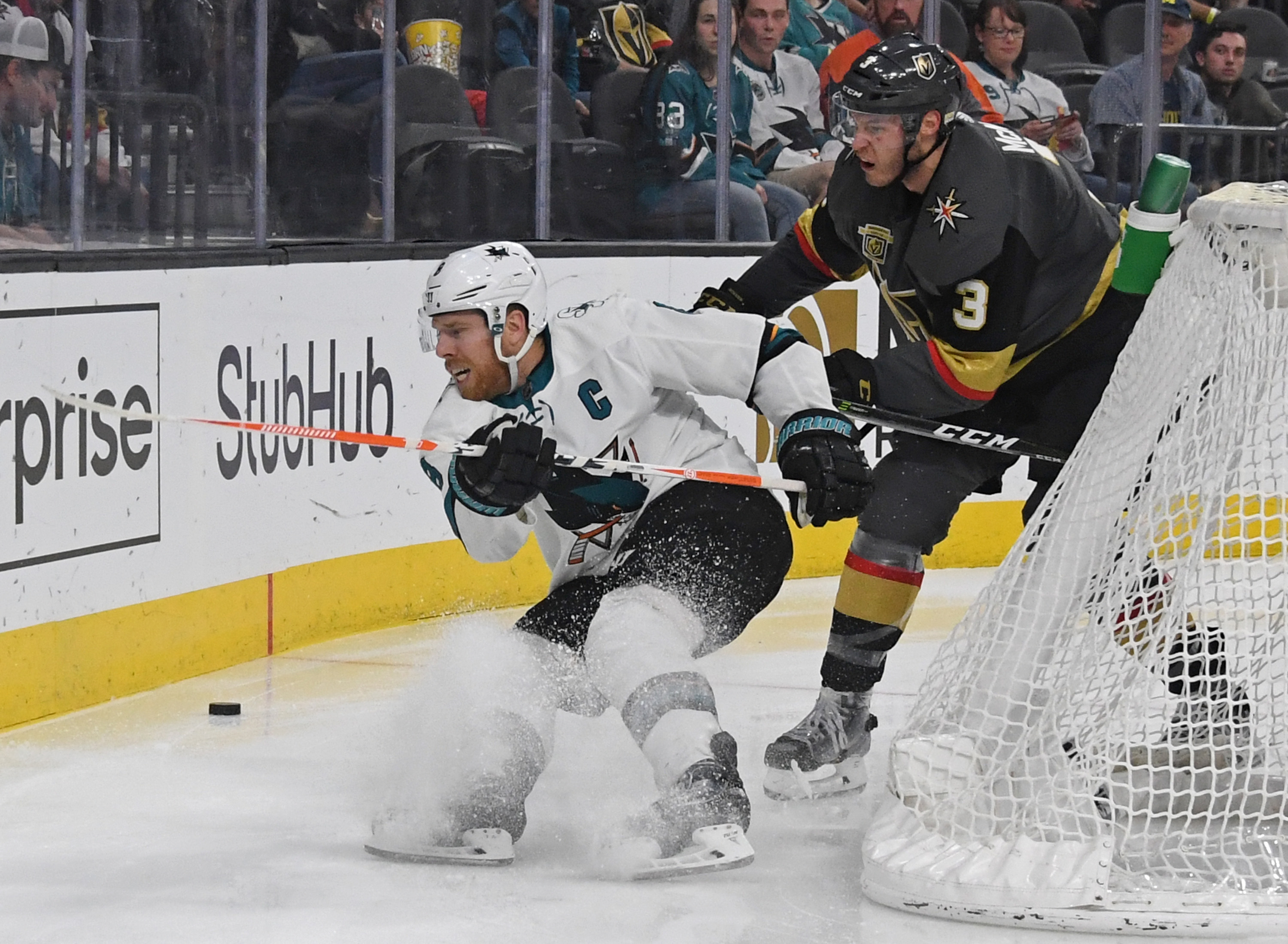 LAS VEGAS, NV - MARCH 31: Joe Pavelski #8 of the San Jose Sharks and Brayden McNabb #3 of the Vegas Golden Knights go after the puck in the third period of their game at T-Mobile Arena on March 31, 2018 in Las Vegas, Nevada. The Golden Knights won 3-2 and