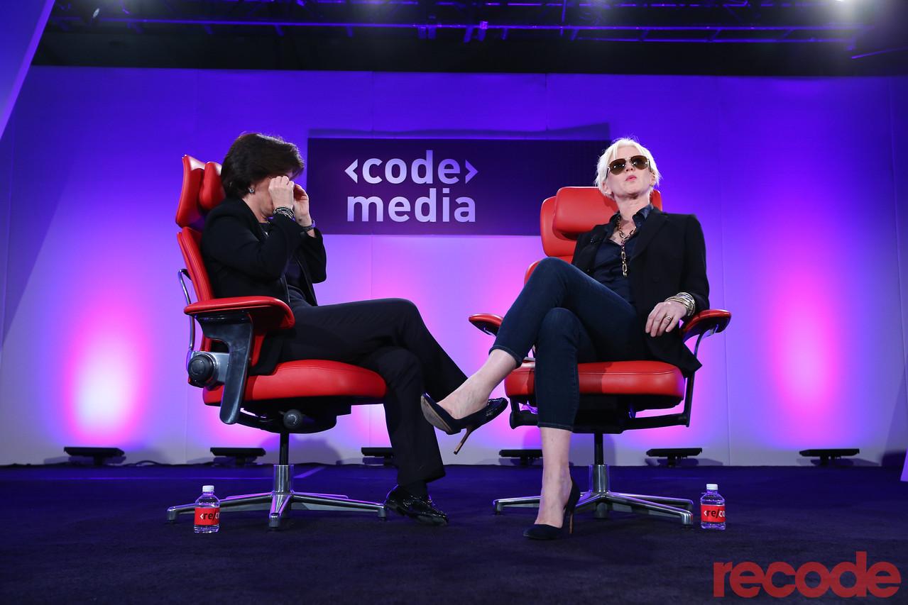Joanna Coles wears Aviator sunglasses onstage with Kara Swisher at Code Media