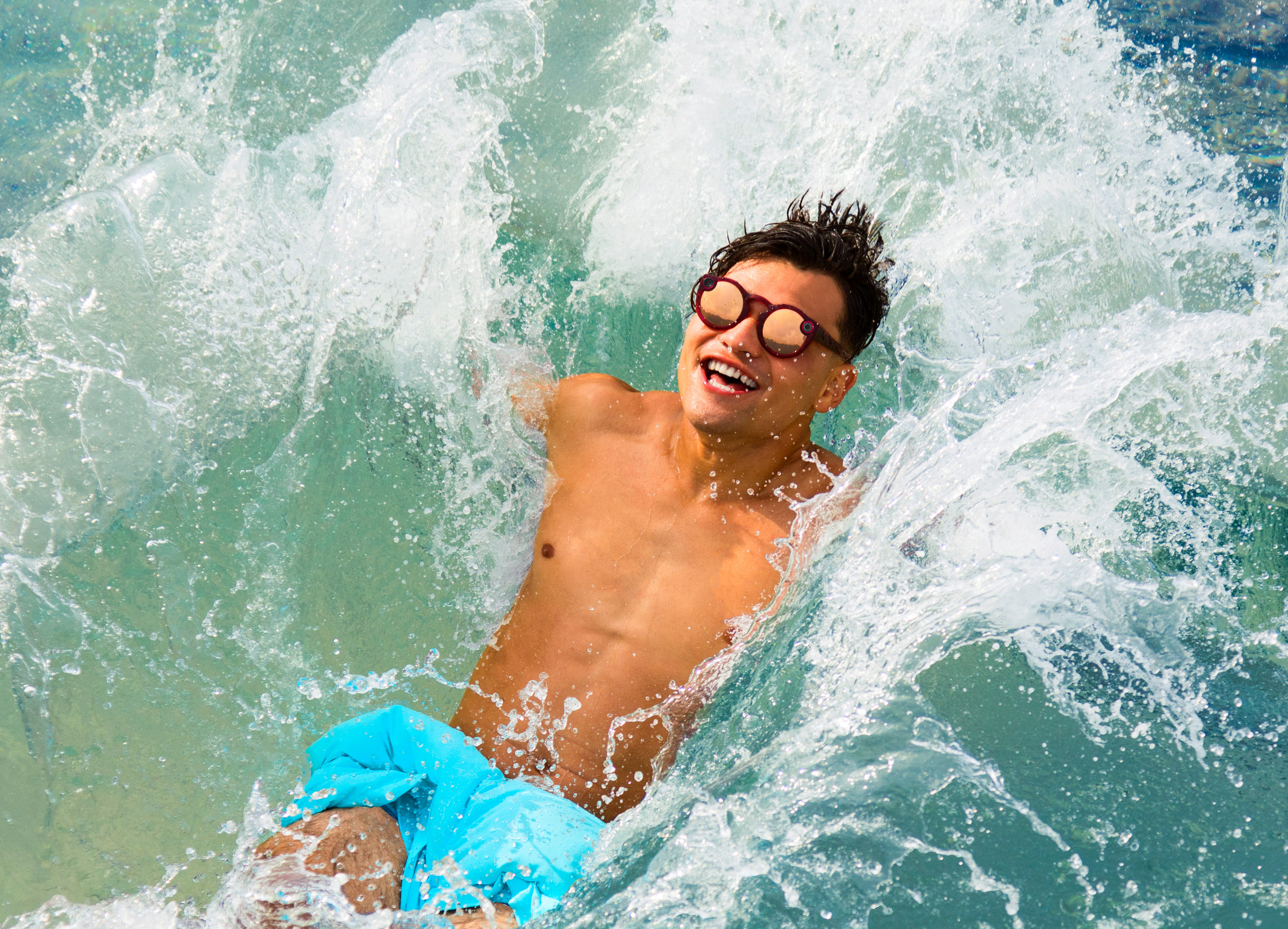 A guy wears Snapchat's new Spectacles as he falls into a pool.
