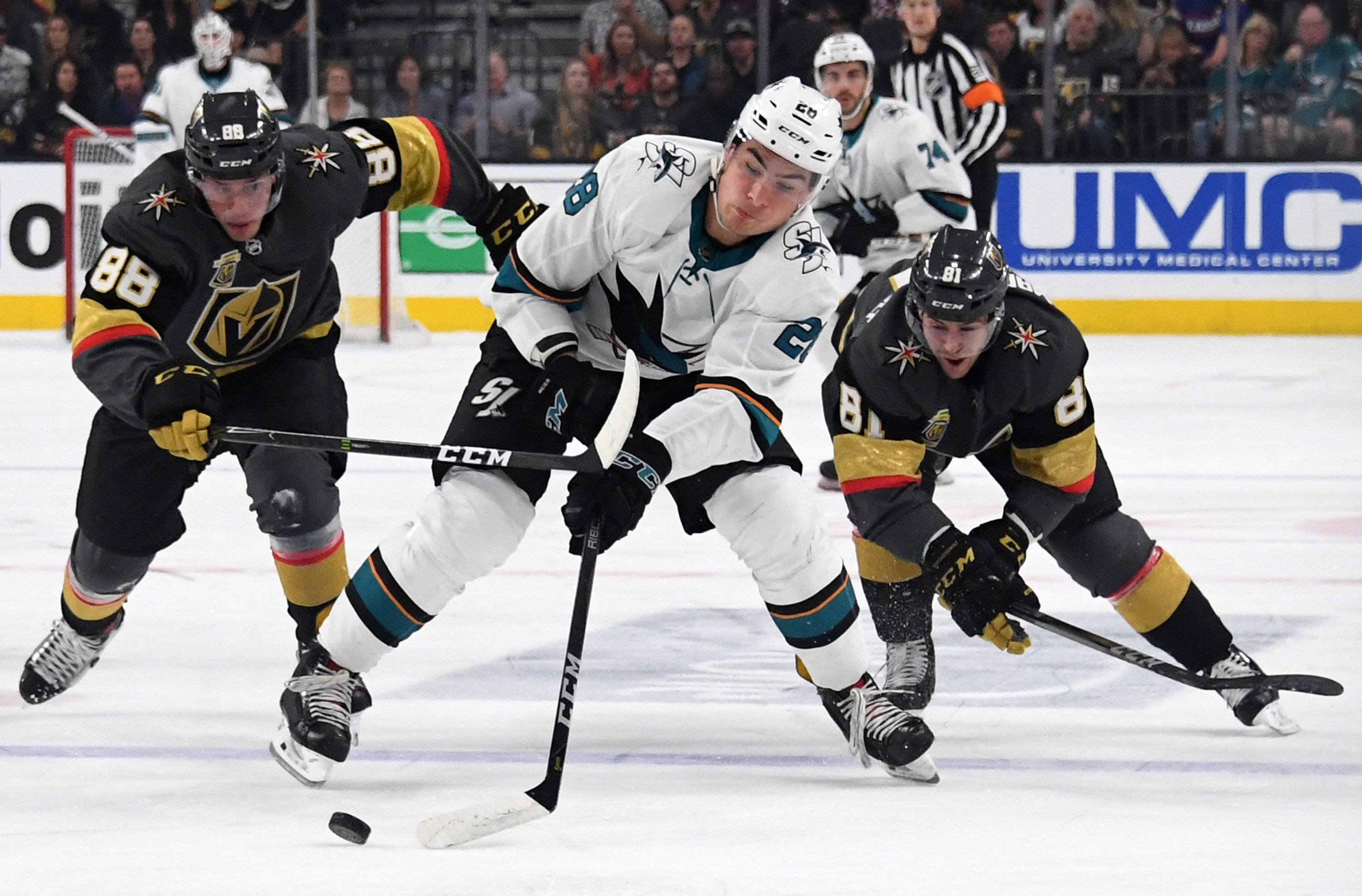 LAS VEGAS, NV - MARCH 31: Timo Meier #28 of the San Jose Sharks skates with the puck under pressure from Nate Schmidt #88 and Jonathan Marchessault #81 of the Vegas Golden Knights in the first period of their game at T-Mobile Arena on March 31, 2018 in La