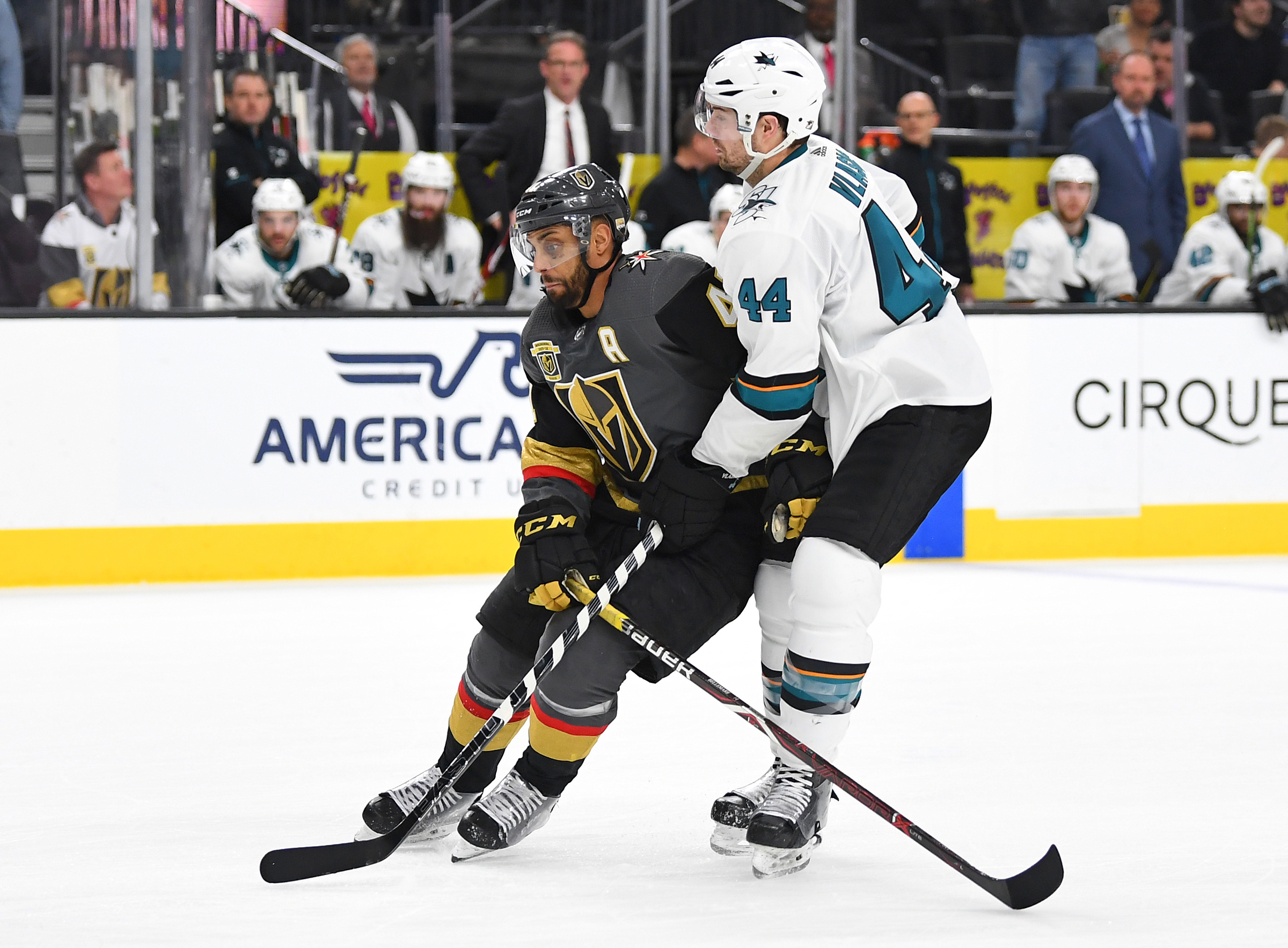 Mar 31, 2018; Las Vegas, NV, USA; San Jose Sharks defenseman Marc-Edouard Vlasic (44) ties up the stick of Vegas Golden Knights left wing Pierre-Edouard Bellemare (41) during the third period at T-Mobile Arena.