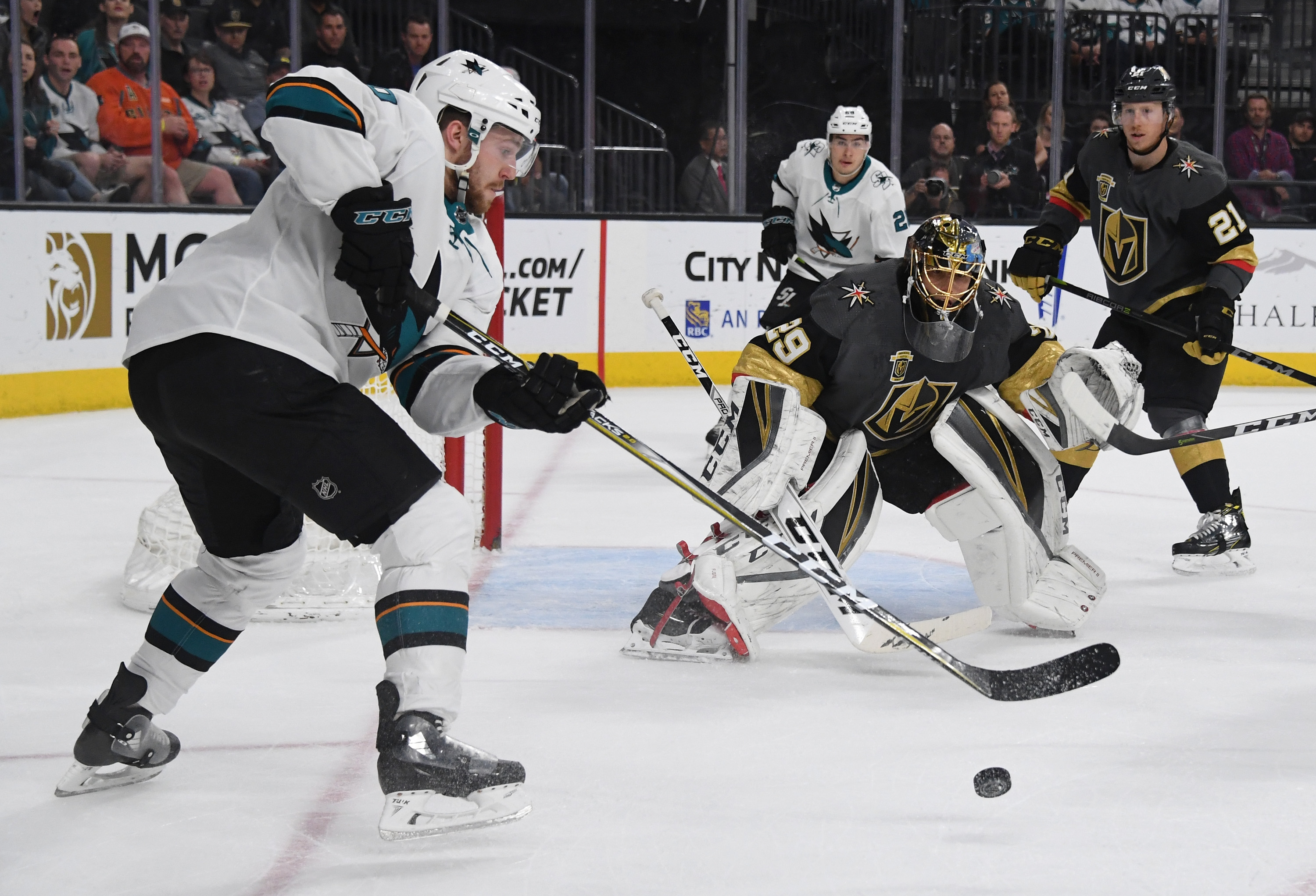 LAS VEGAS, NV - MARCH 31: Chris Tierney #50 of the San Jose Sharks tries to get a shot off on Marc-Andre Fleury #29 of the Vegas Golden Knights in the first period of their game at T-Mobile Arena on March 31, 2018 in Las Vegas, Nevada.