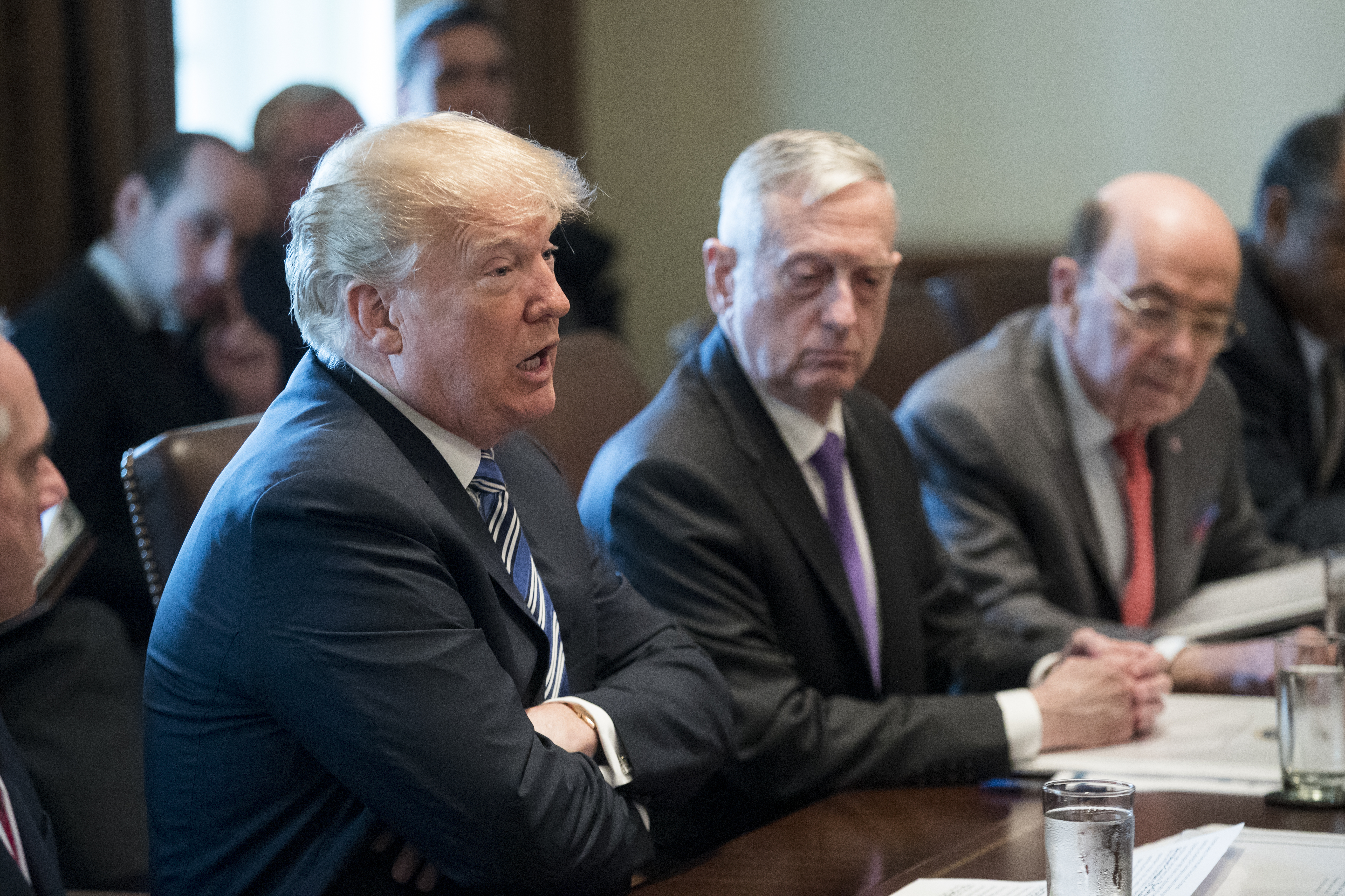 President Donald Trump (L) speaks beside US Secretary of Defense Jim Mattis (C) during a meeting with members of his Cabinet on March 8, 2018.