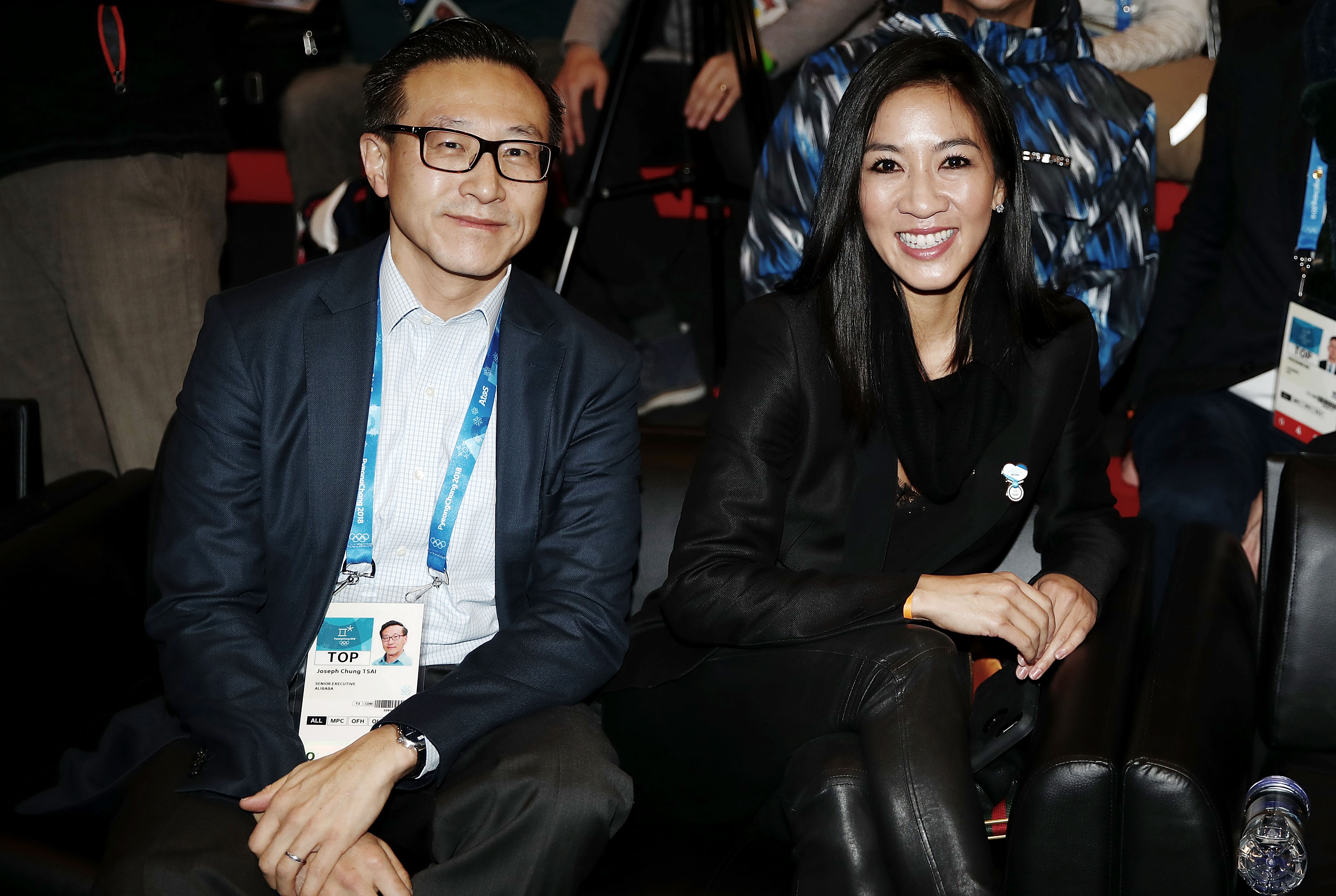 Alibaba co-founder and Executive Vice Chairman Joe Tsai, left, with Olympic figure skater Michelle Kwan