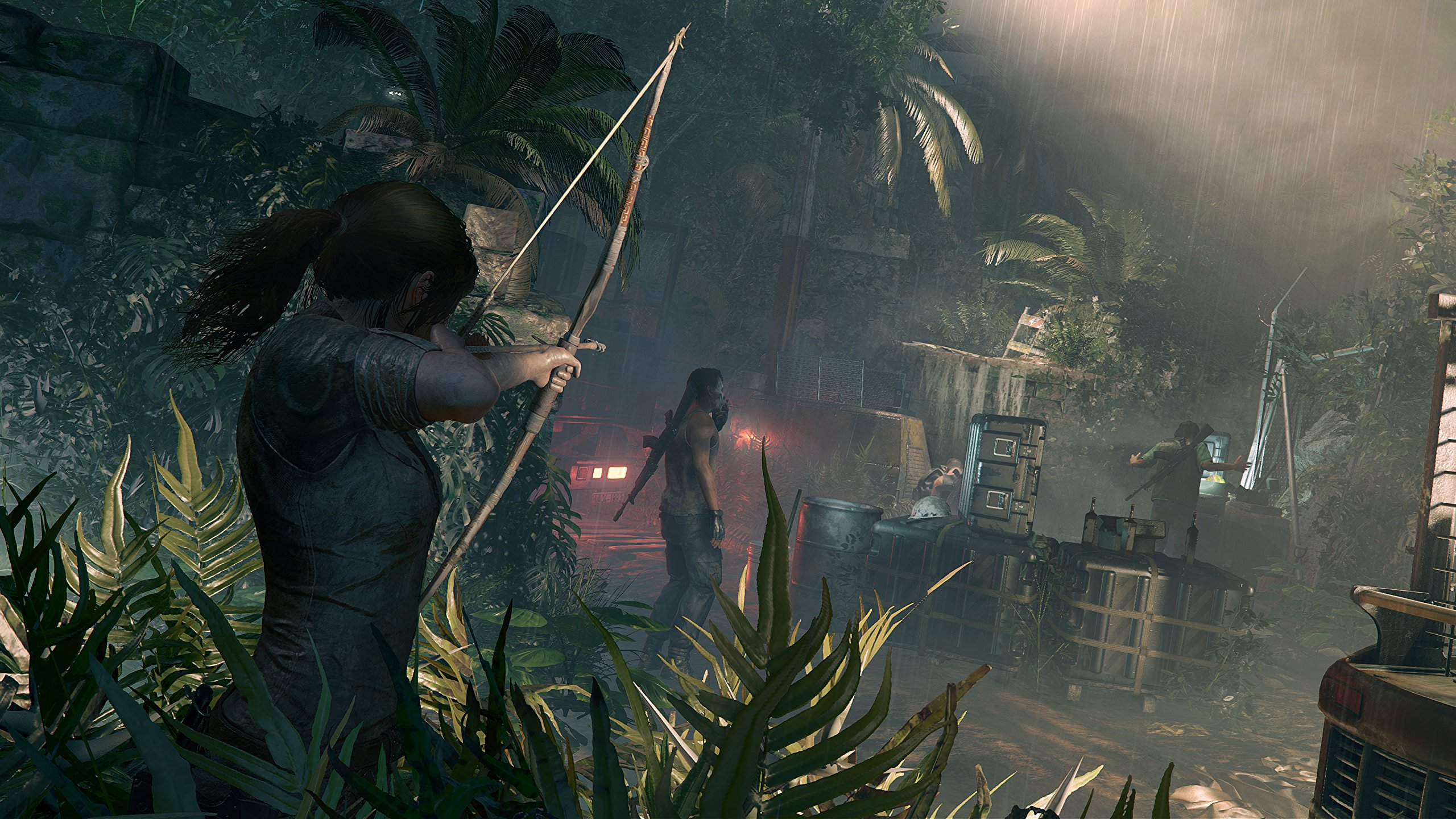 Shadow of the Tomb Raider - Lara aiming her bow at some enemies in the jungle