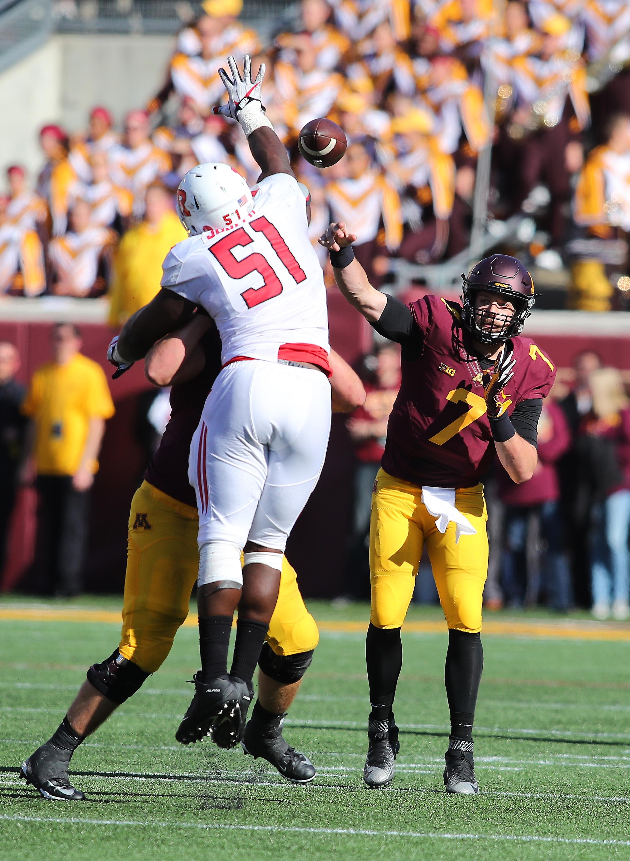 Rutgers DL Sebastian Joseph tries to knock down a pass from Minnesota QB Mitch Leidner