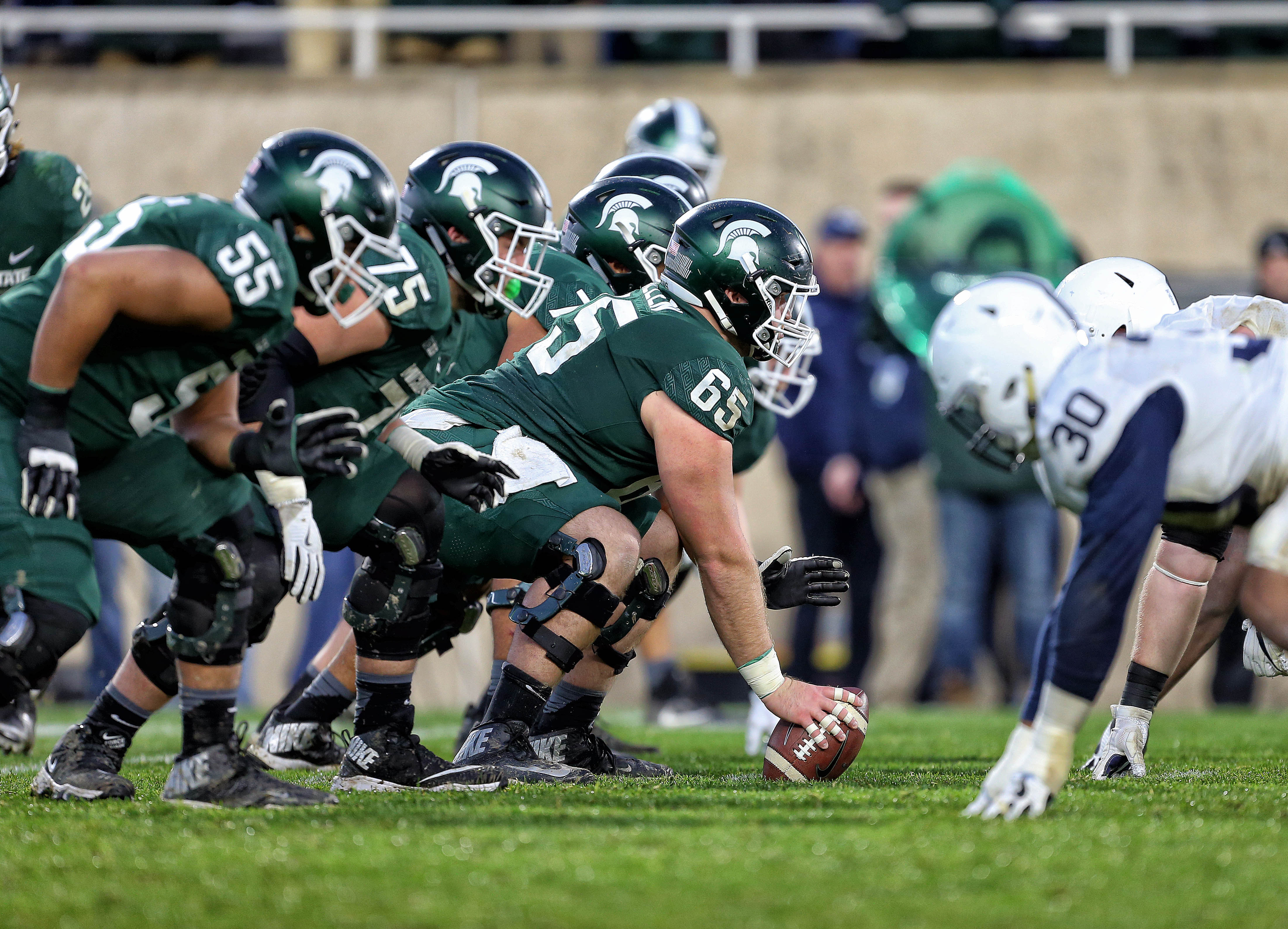 Michigan State C Brian Allen prepares to snap the ball against Penn St. in 2017