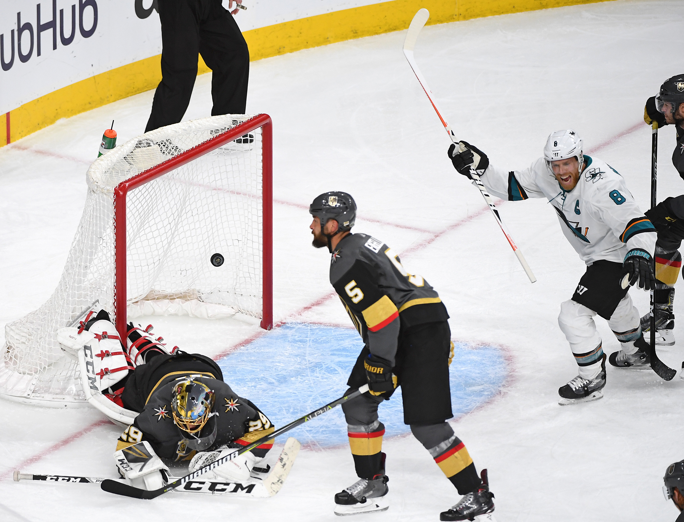 Apr 28, 2018; Las Vegas, NV, USA; San Jose Sharks center Joe Pavelski  (8) celebrates after San Jose Sharks center Logan Couture (39) scores in  double overtime of game two of the second round of the 2018 Stanley Cup  Playoffs to give the Sharks a 4-3 vic