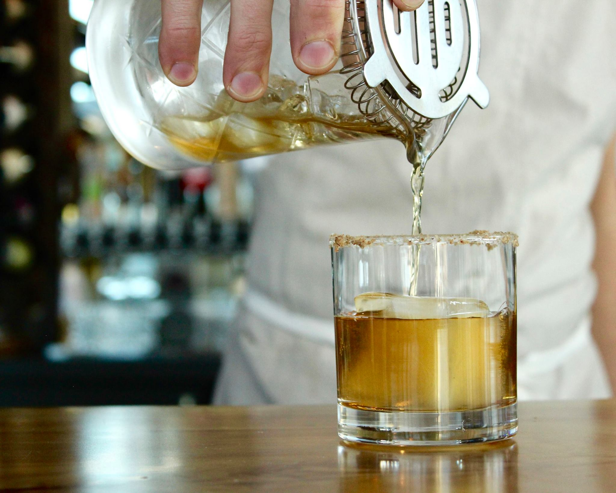 Pouring a drink at Emmer & Rye