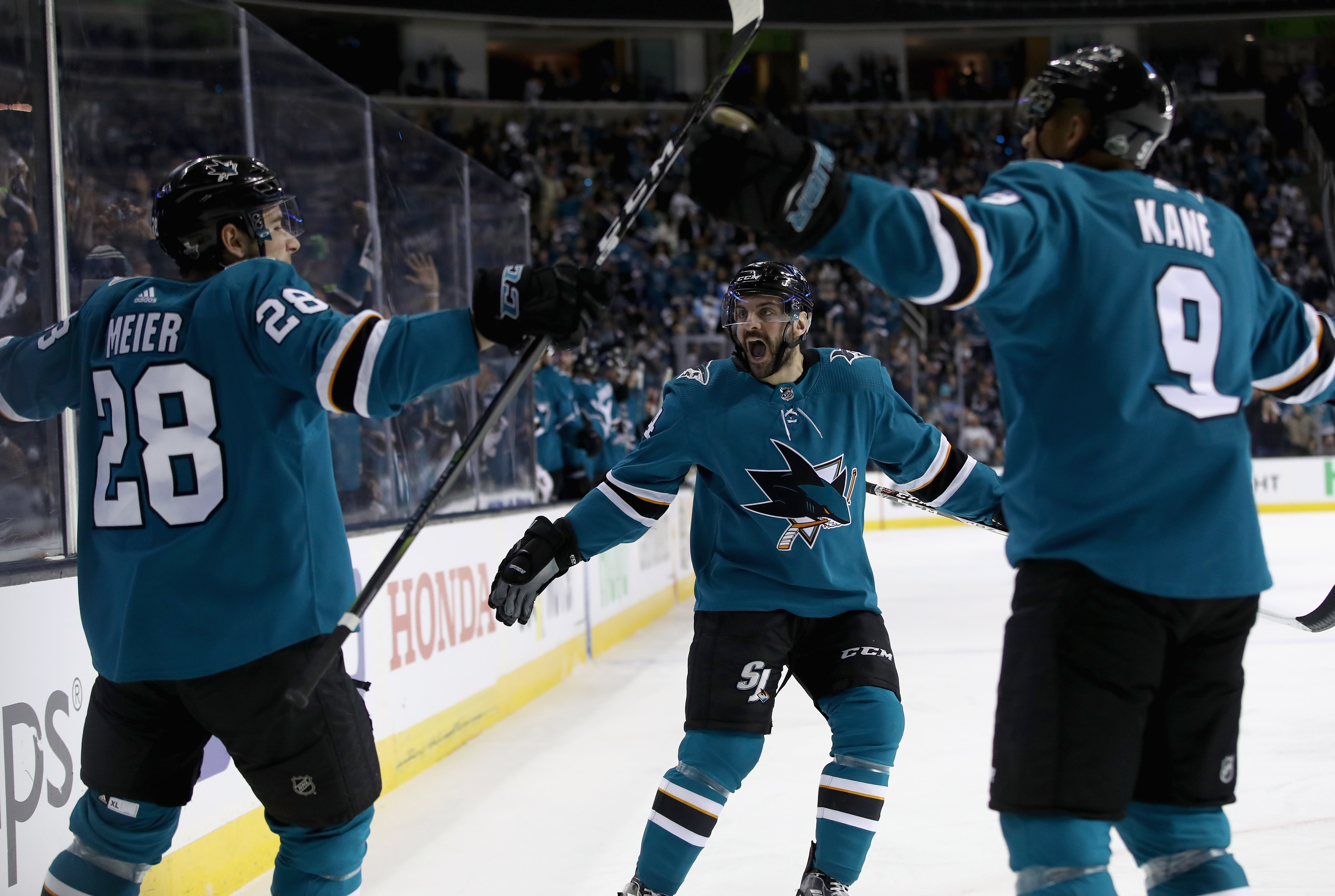 SAN JOSE, CA - APRIL 30: Dylan DeMelo #74 of the San Jose Sharks celebrates with Timo Meier #28 and Evander Kane #9 after Meier scored a goal against the Vegas Golden Knights during Game Three of the Western Conference Second Round during the 2018 NHL Sta