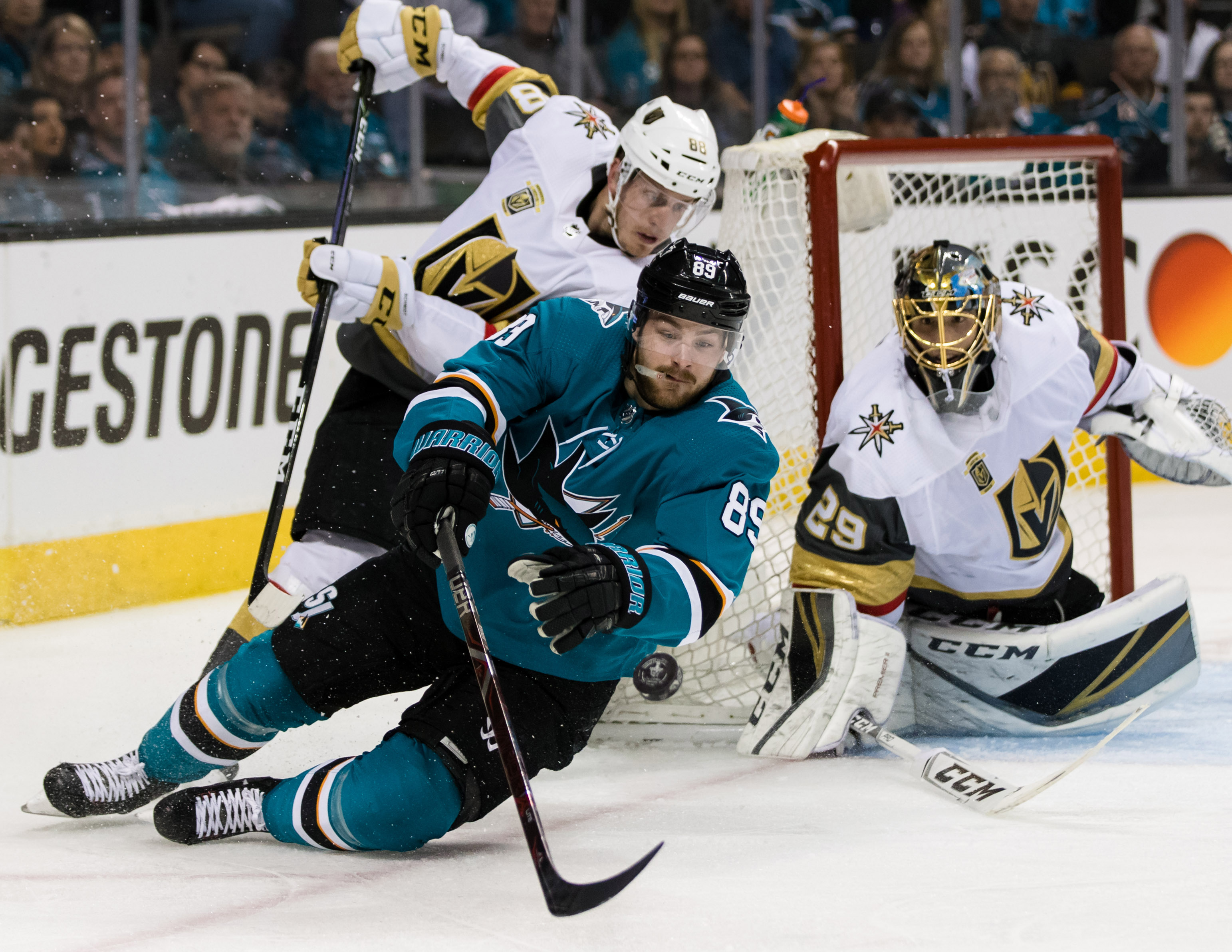 Apr 30, 2018; San Jose, CA, USA; San Jose Sharks left wing Mikkel Boedker (89) and Vegas Golden Knights defenseman Nate Schmidt (88) battle for possession in the second period of game three of the second round of the 2018 Stanley Cup Playoffs at SAP Cente
