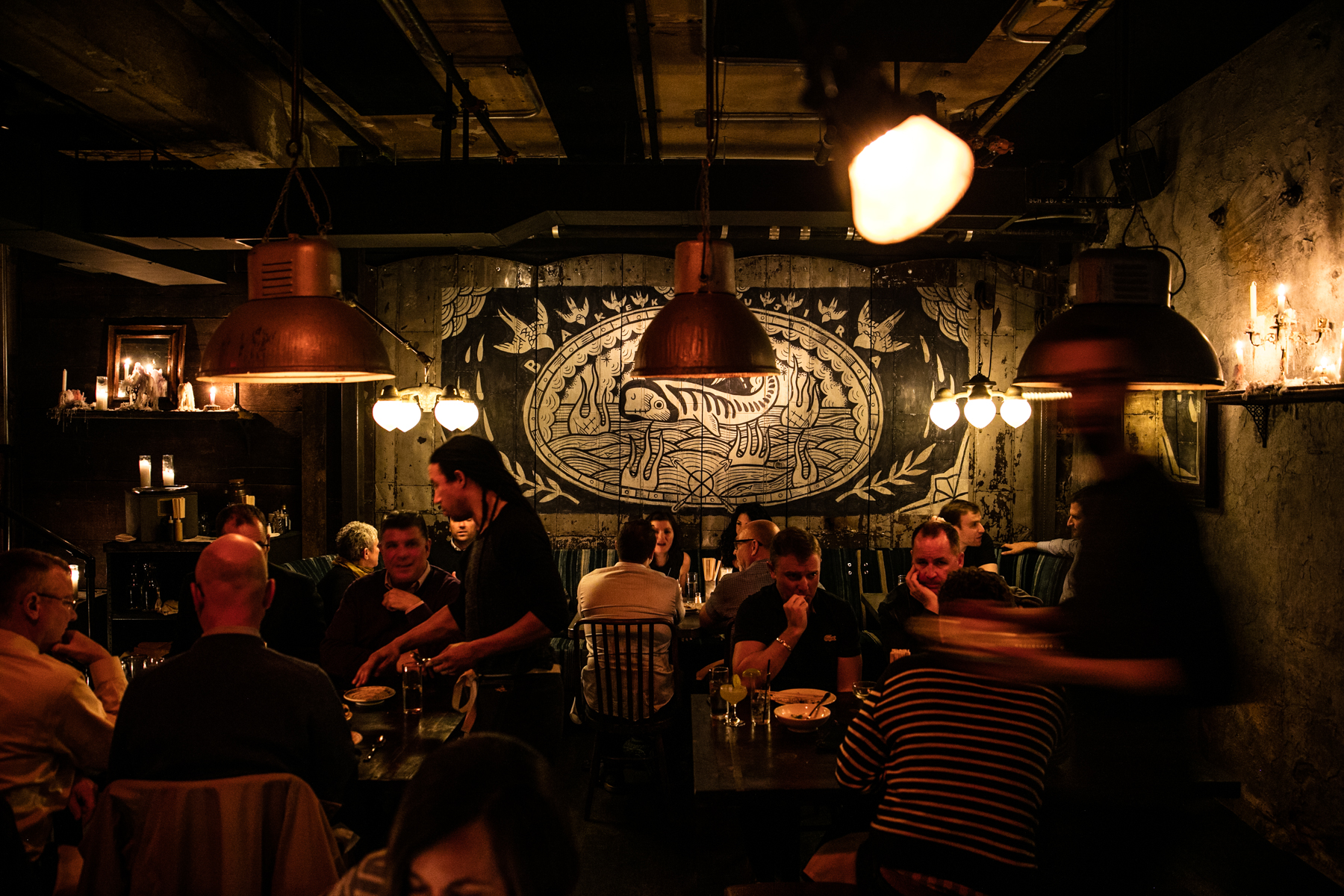 dark restaurant with black and white painting