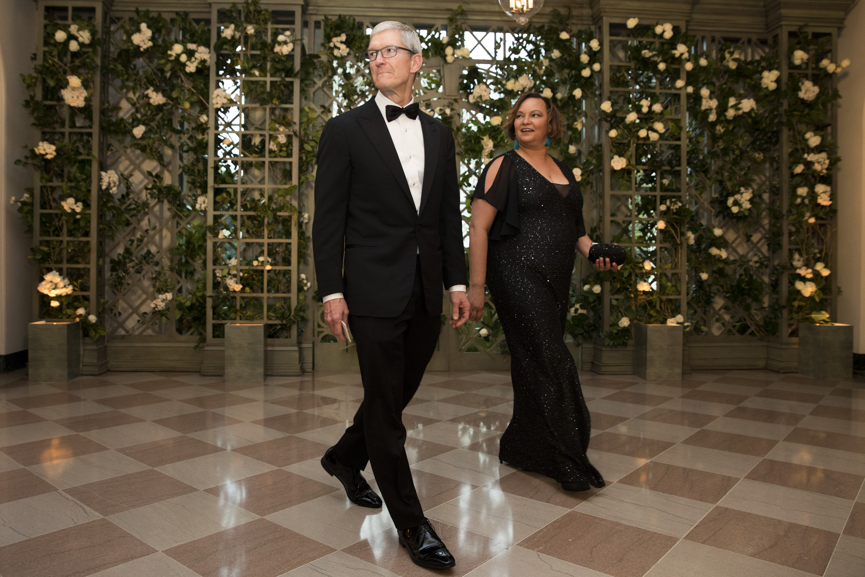 Apple CEO Tim Cook and Lisa Jackson arrive at a gala