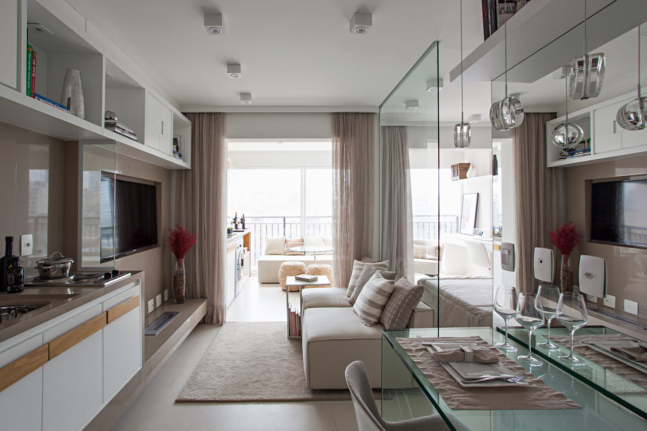Interior shot of bright one-room apartment with integrated elements.