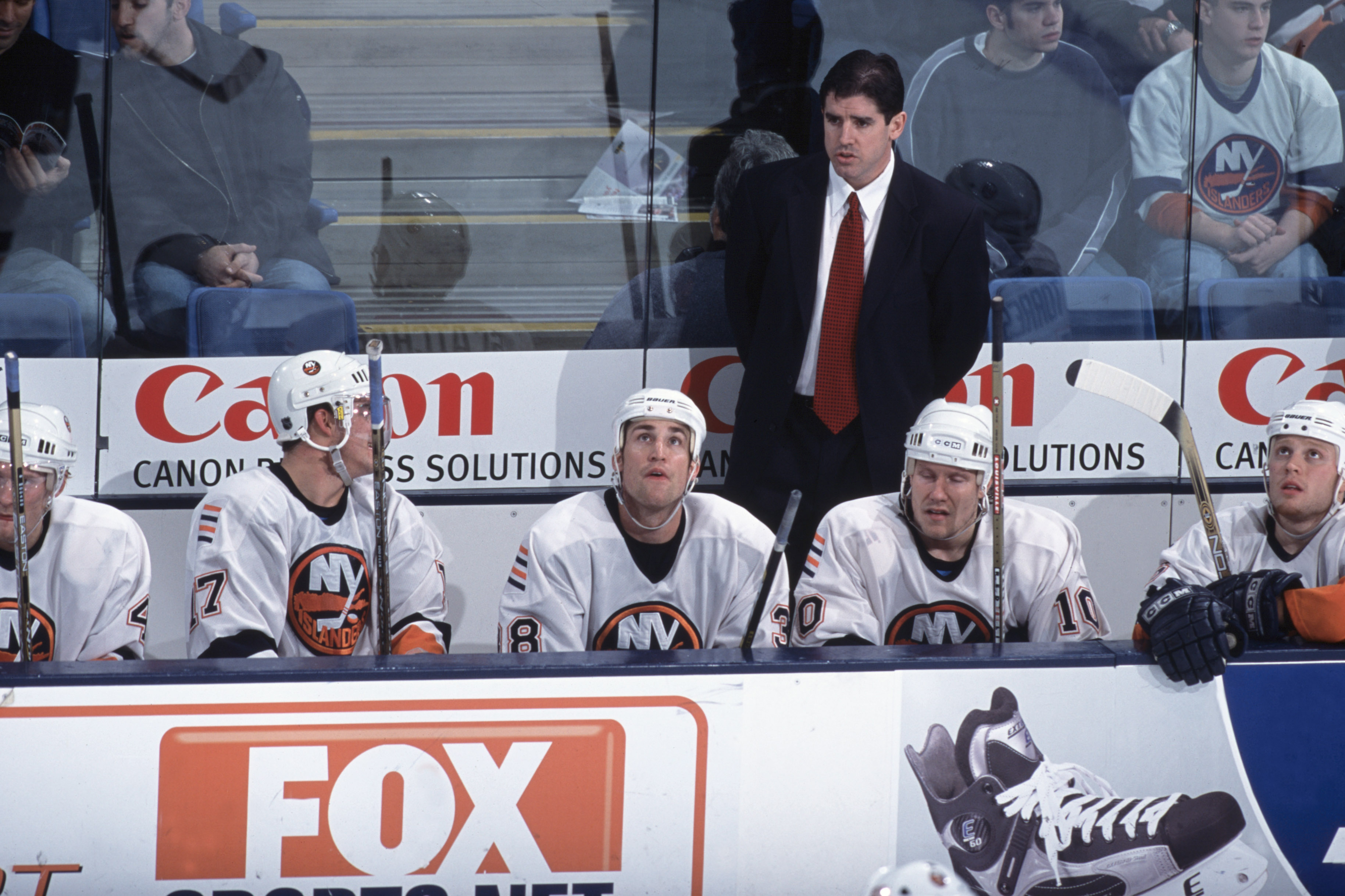 Peter Laviolette stands on the bench