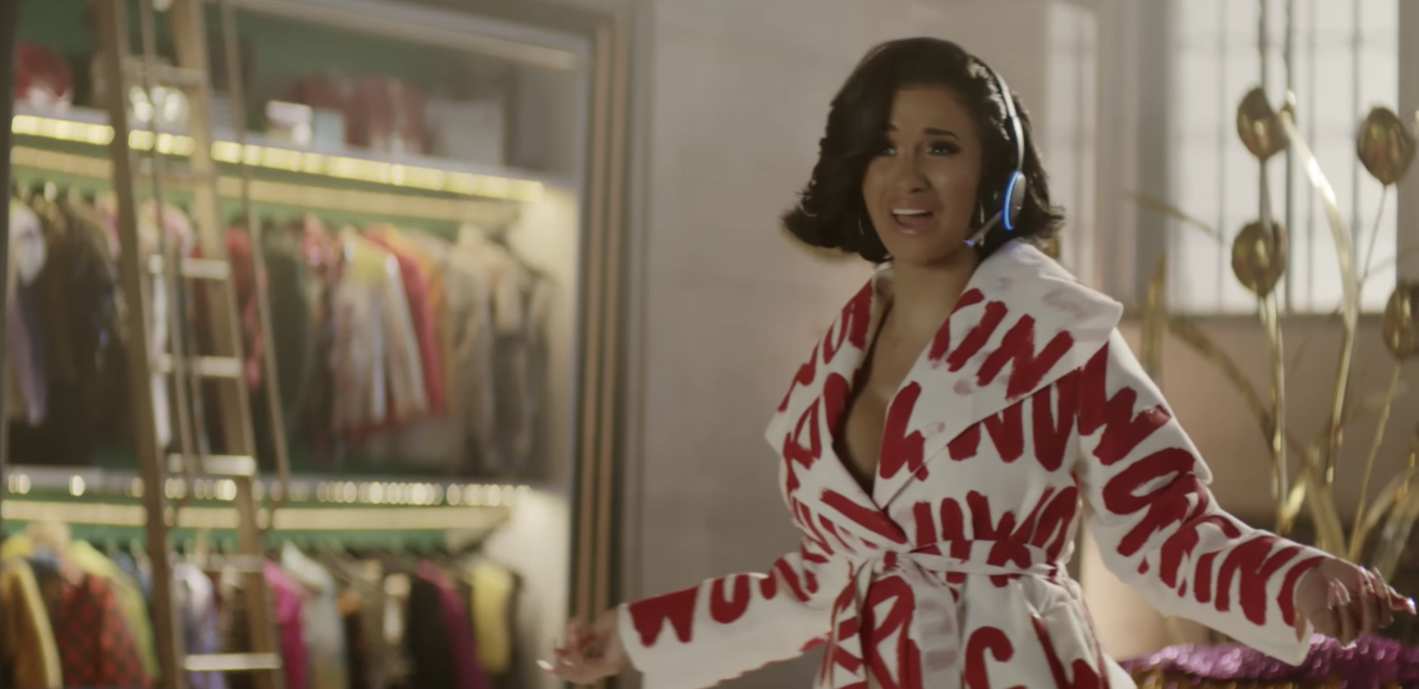 Singer Cardi B wears a headset and microphone to act as Amazon's voice assistant, Alexa.