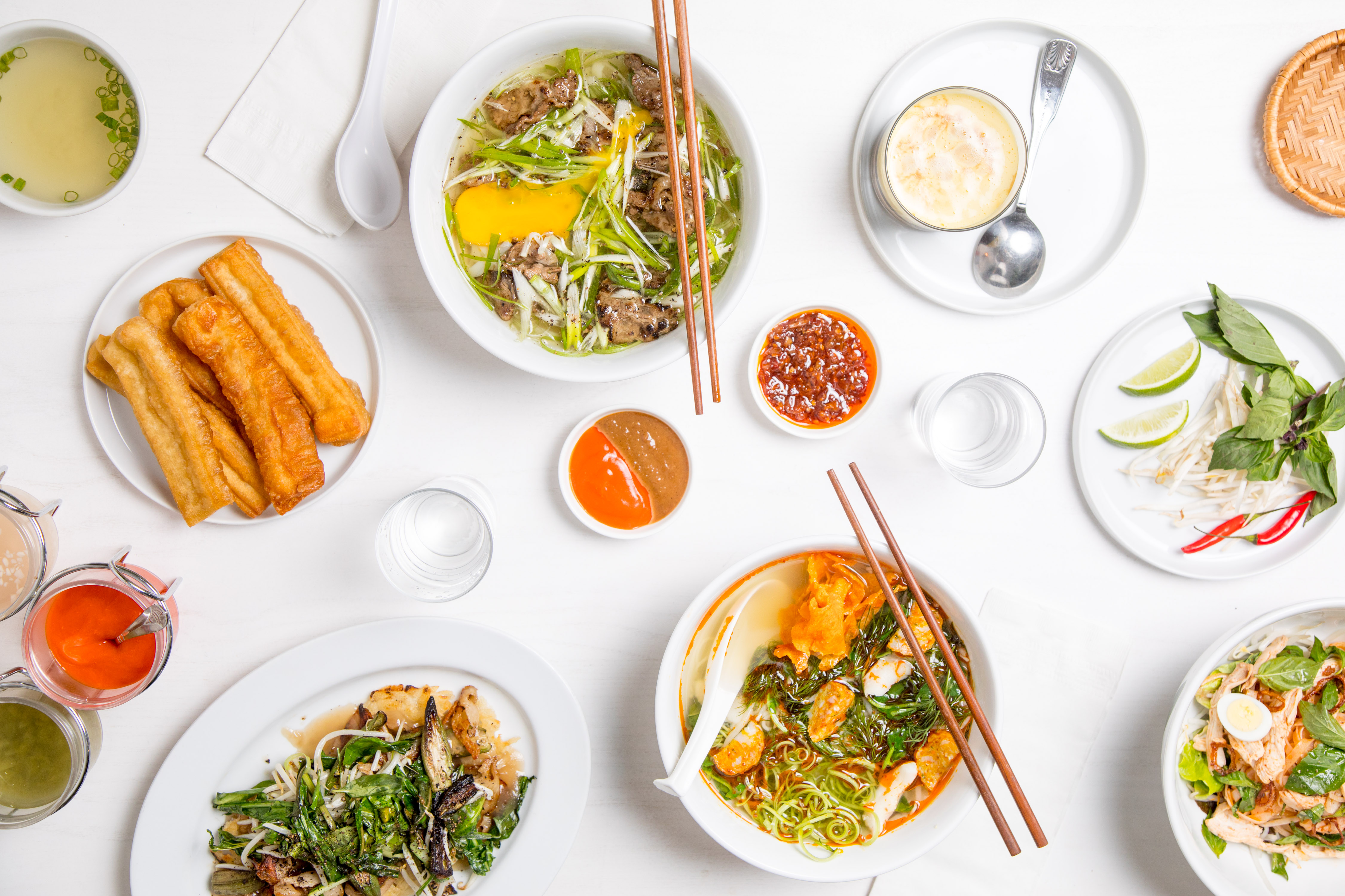 A spread of pho and other dishes at Di An Di