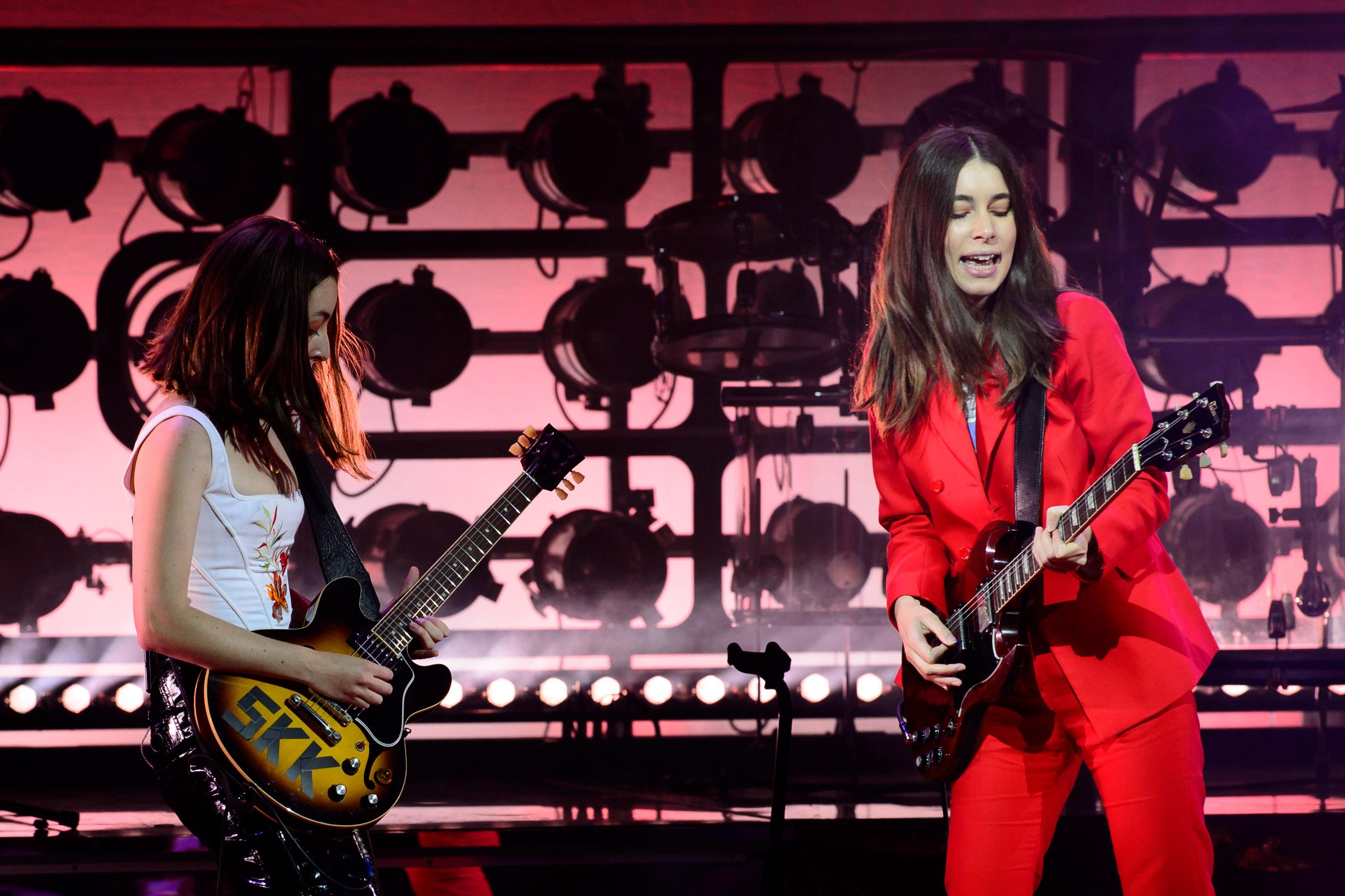 Both sisters play guitar.