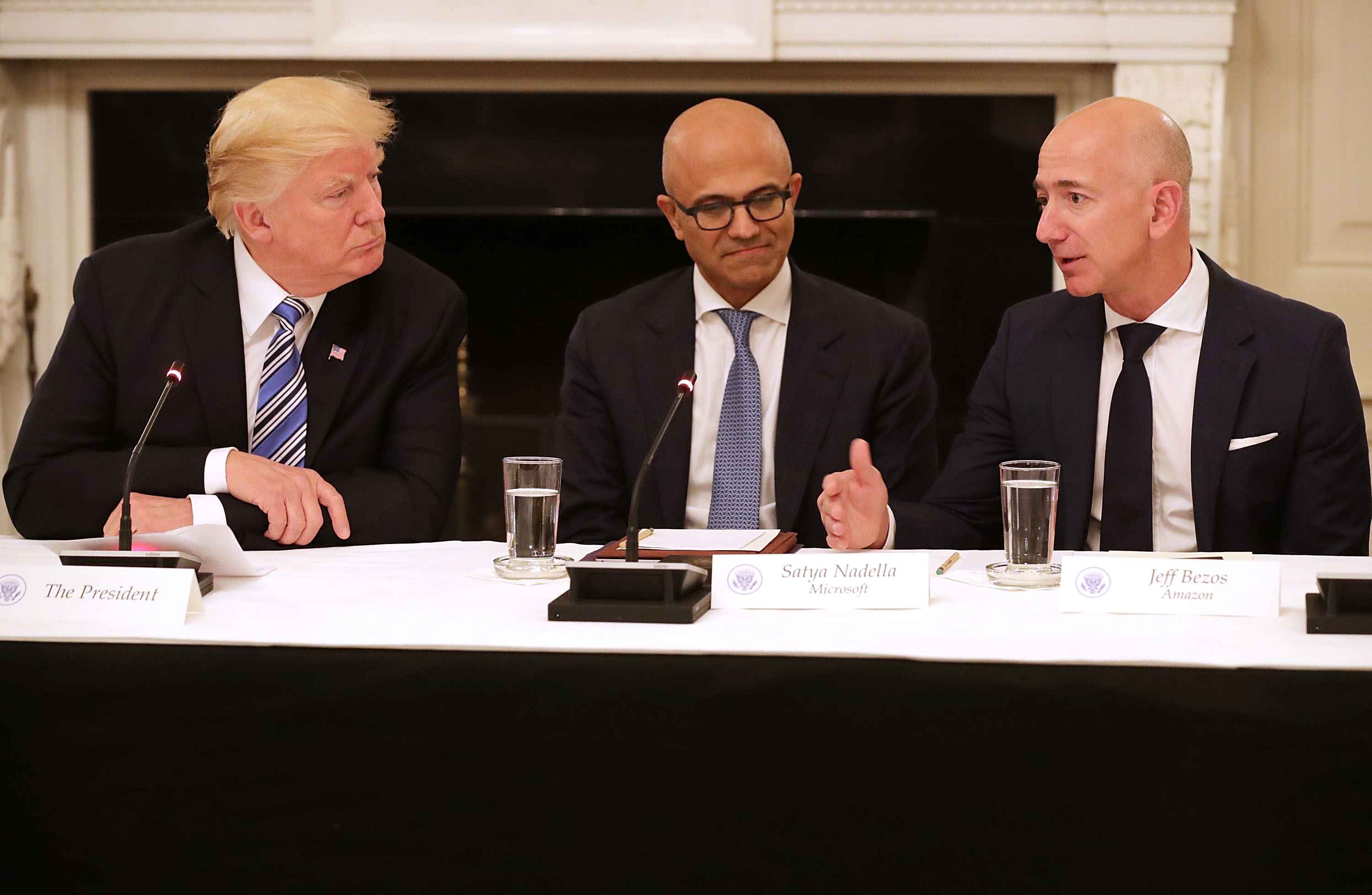 U.S. President Donald Trump, Microsoft CEO Satya Nadella and Amazon CEO Jeff Bezos attend a meeting of the American Technology Council in the State Dining Room of the White House June 19, 2017 in Washington, DC.