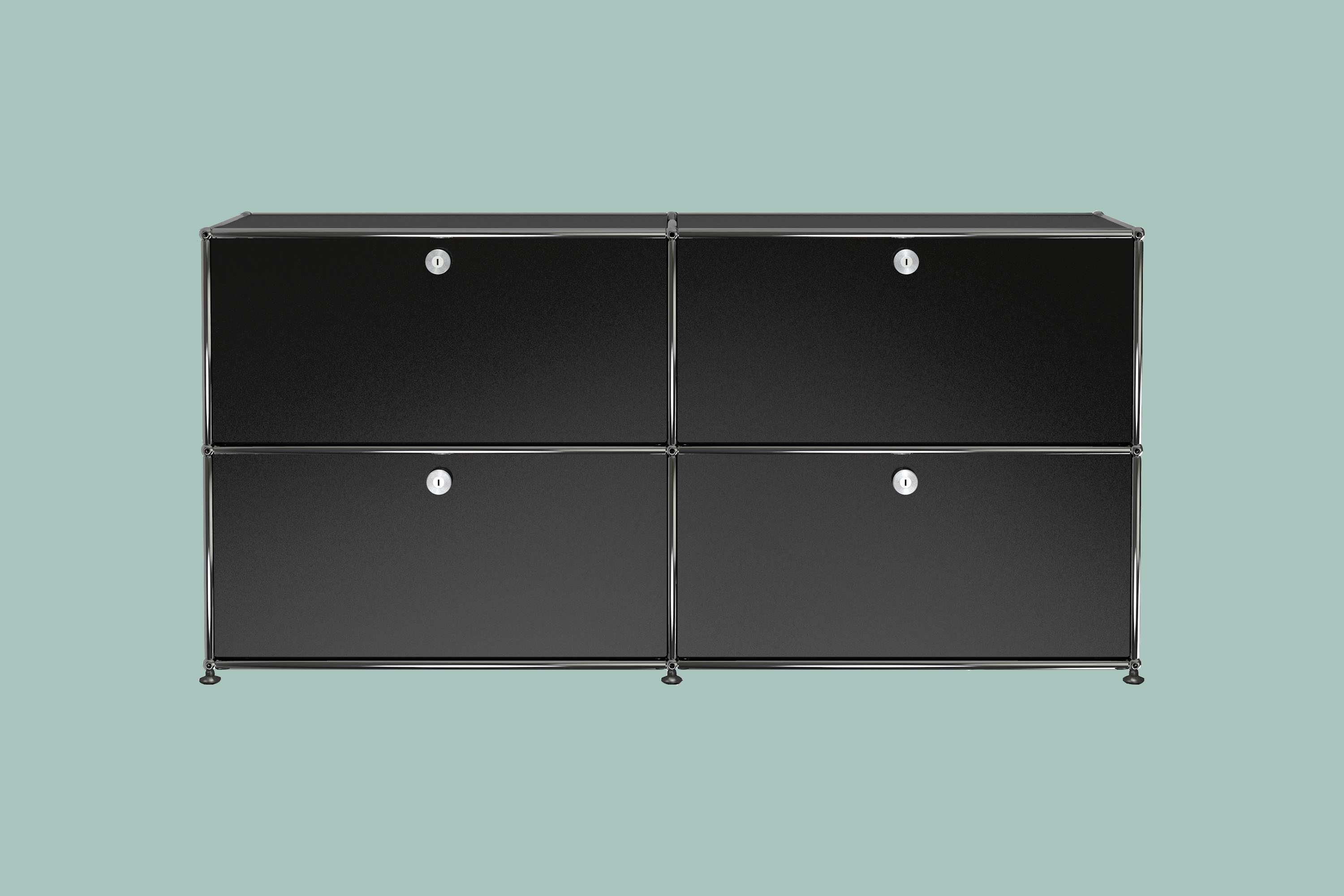 Black dresser with two rows of two compartments with silver edging and finishes.