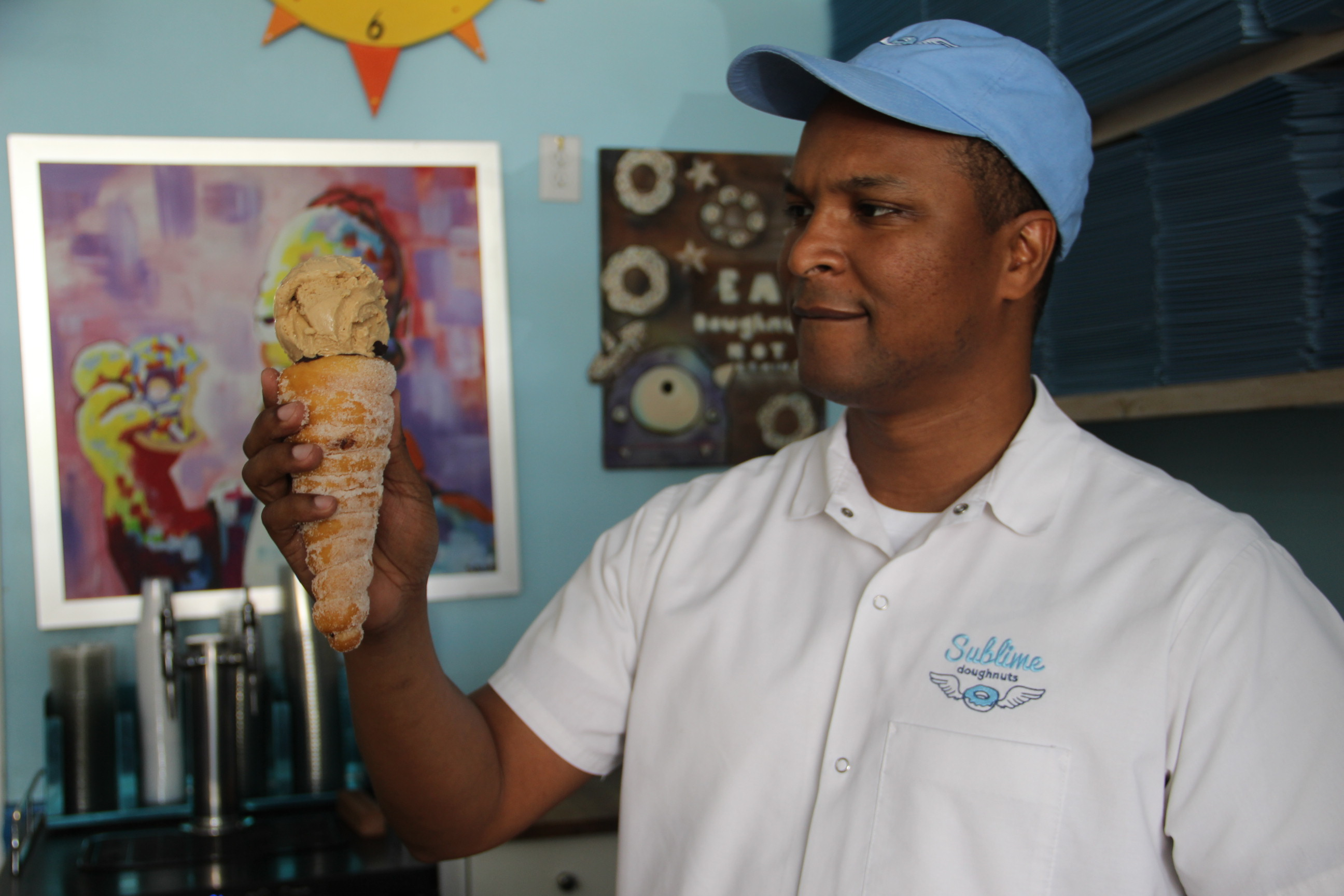 Sublime Doughnuts' owner Kamal Grant and his doughnut ice cream cone