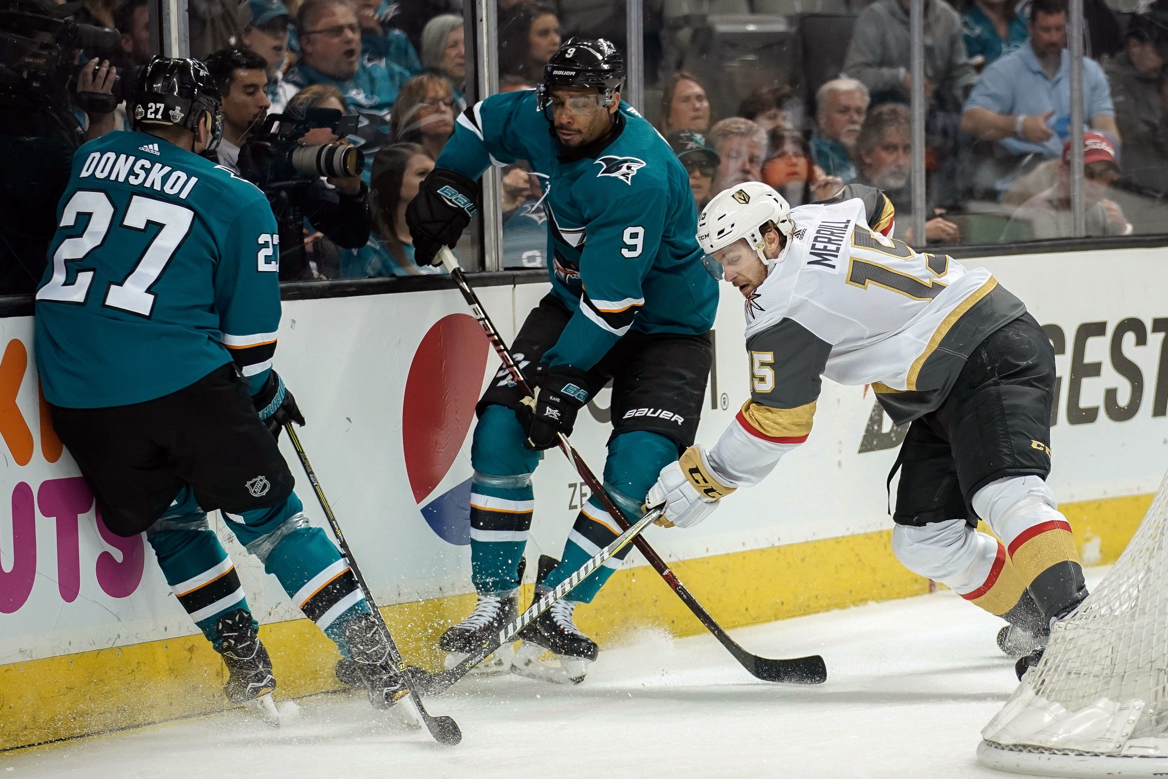 May 2, 2018; San Jose, CA, USA; Vegas Golden Knights defenseman Jon Merrill (15) fights for control of the puck against San Jose Sharks right wing Joonas Donskoi (27) and left wing Evander Kane (9) during the second period in game four of the second round