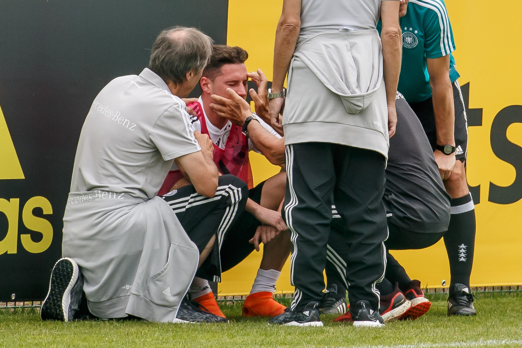 Germany - Southern Tyrol Training Camp Day 7 BOLZANO, ITALY - MAY 29: Julian Draxler of Germany receives medical help during day seven of the Southern Tyrol Training Camp on May 29, 2018 in Eppan, Italy.