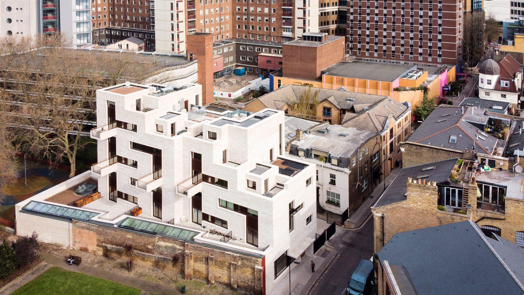 Tetris style brick complex in shadow of London Shard