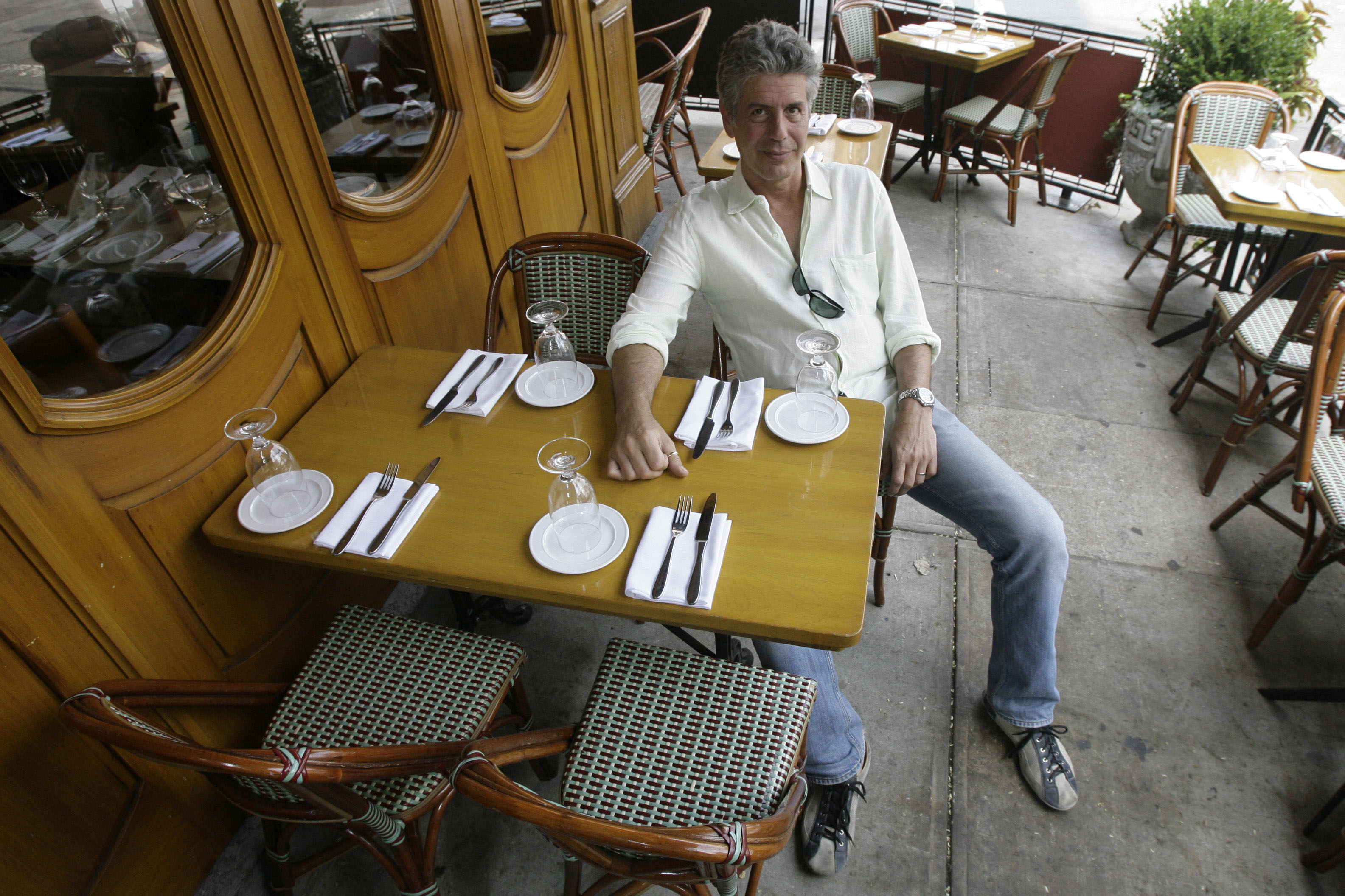 """Anthony Bourdain, host of theTravel Channel's """"No Reservations,"""" poses in a New York restaurant, Wednesday, Aug. 8, 2007."""