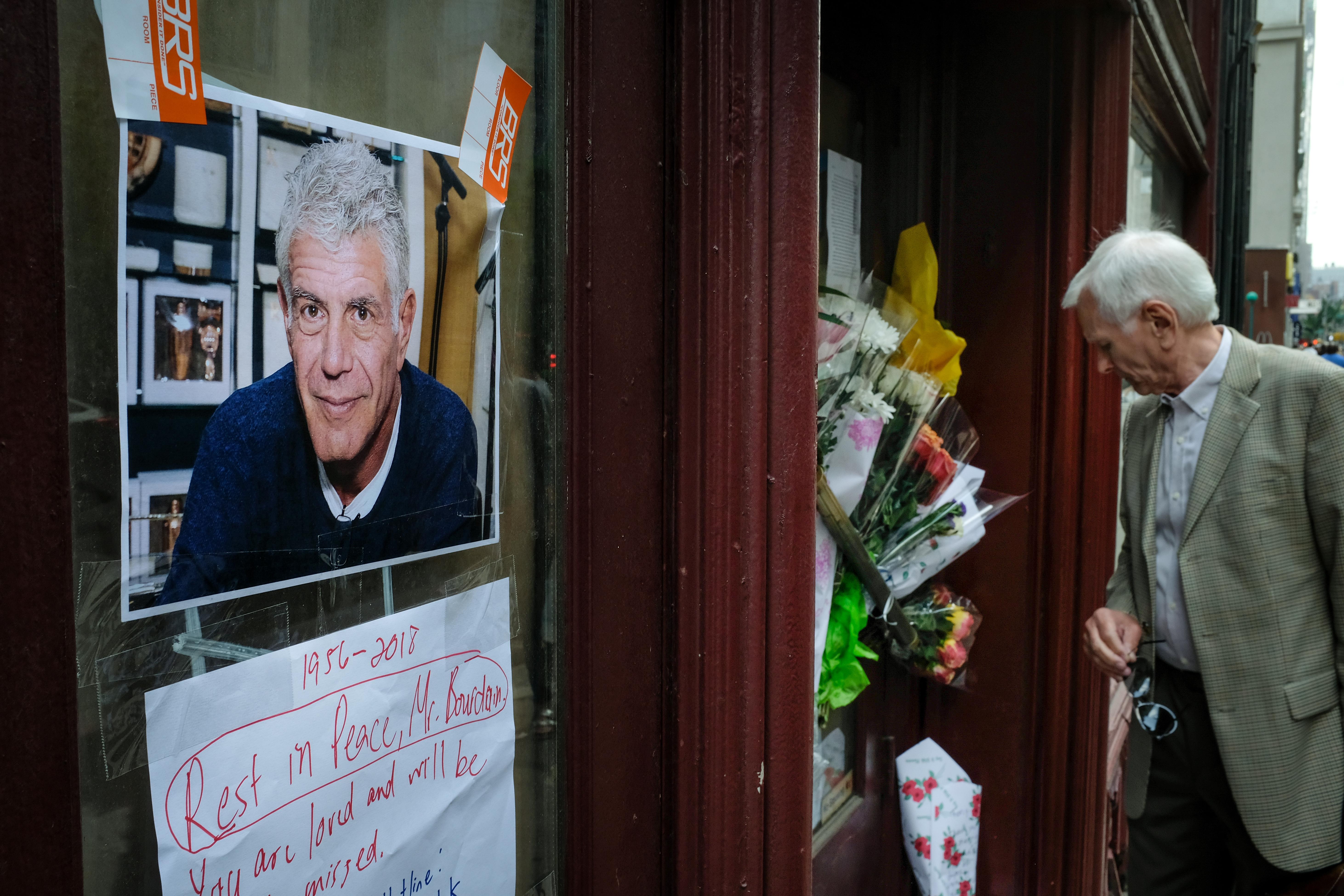 Flowers outside Anthony Bourdain's former restaurant