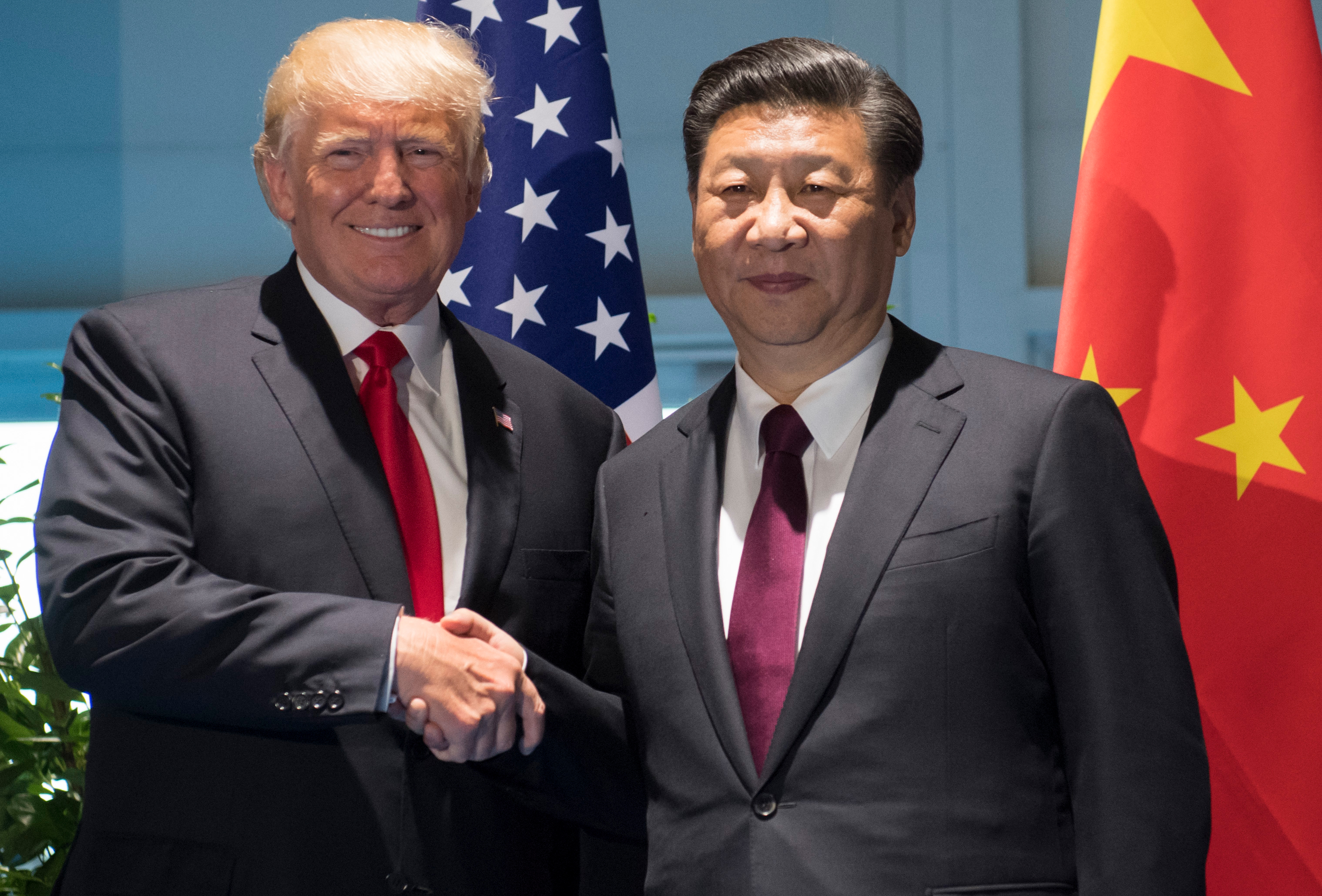 US President Donald Trump and Chinese President Xi Jinping shake hands prior to a meeting on the sidelines of the G20 Summit in Hamburg, Germany, July 8, 2017.