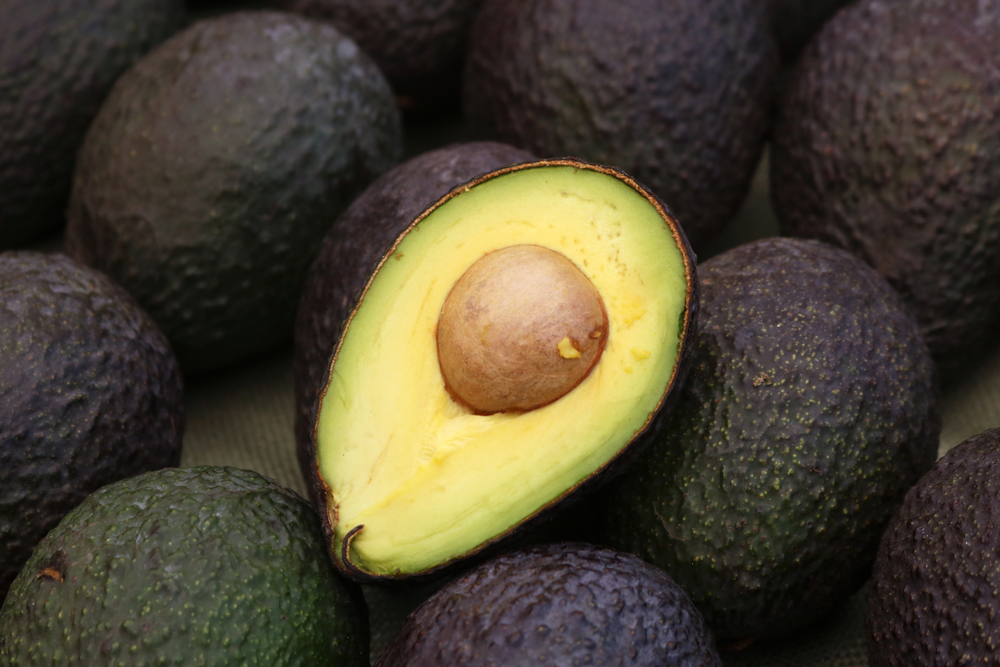A pile of ripe avocados